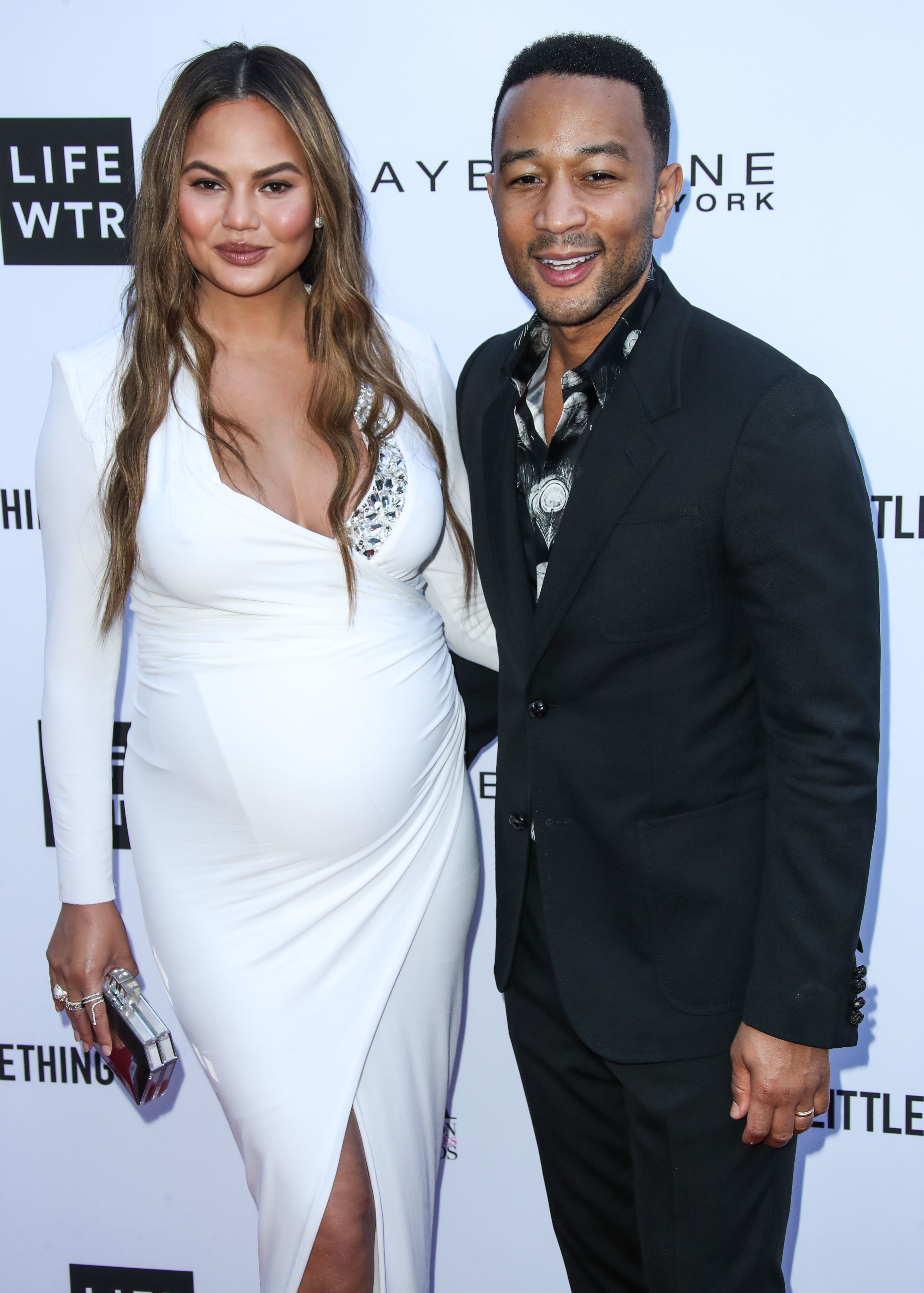 Chrissy Teigen and John Legend arrive at the Daily Front Row Fashion Awards in Los Angeles on April 8, 2018.