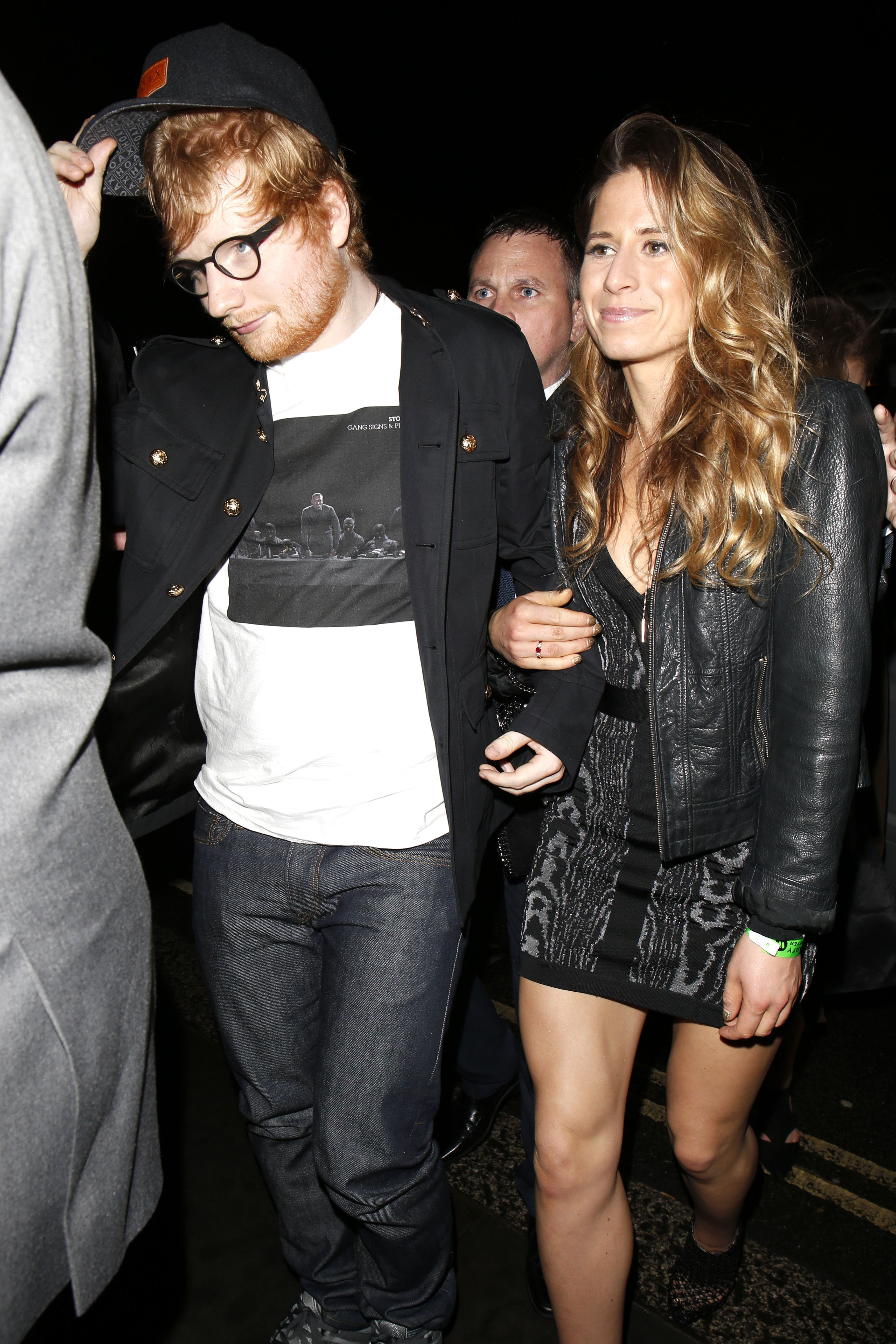 Ed Sheeran and Cherry Seaborn leave the Warner Music Brit Awards afterparty in London on Feb. 22, 2017.