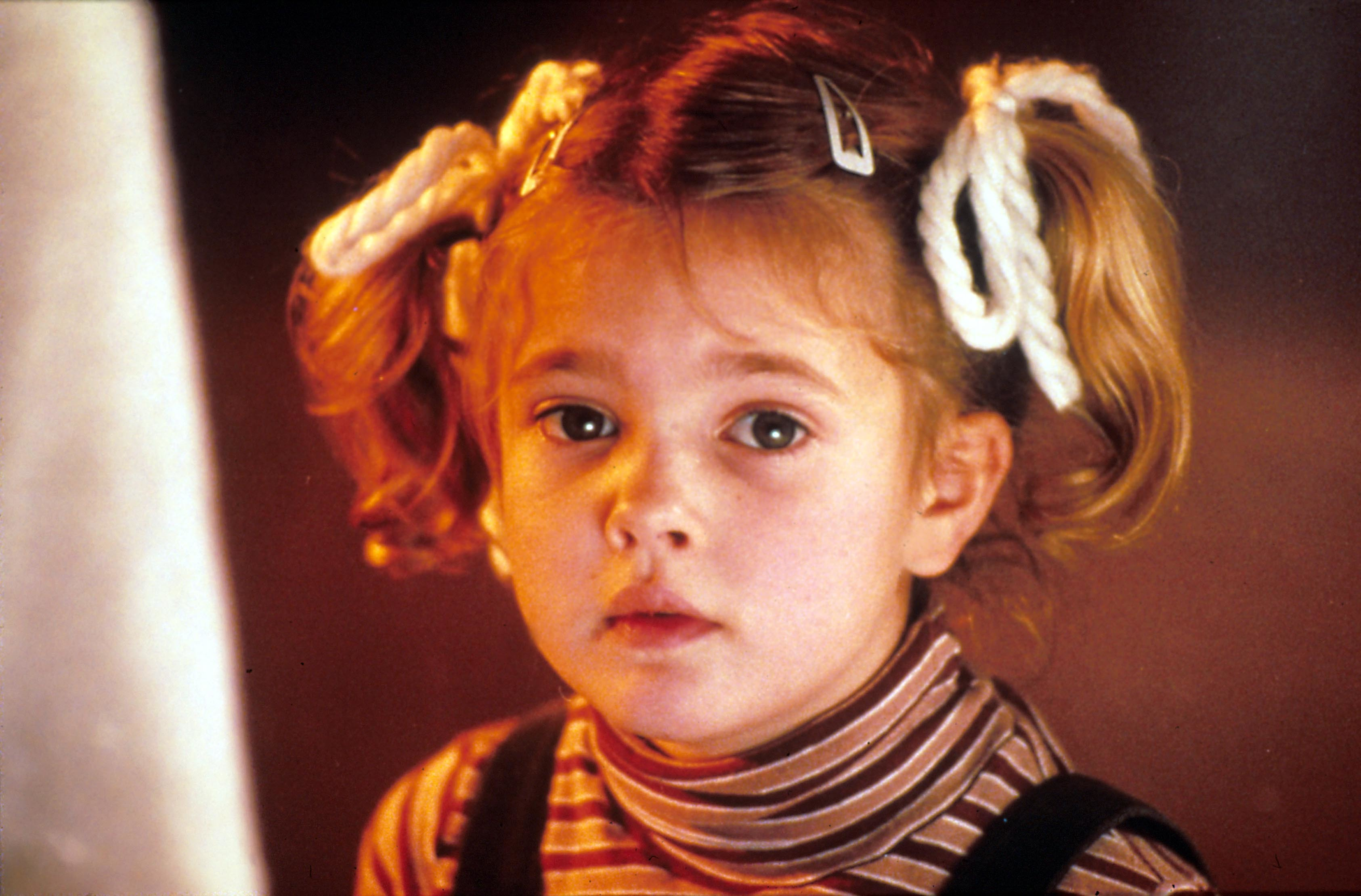 "Drew Barrymore in ""E.T.: The Extra Terrestrial."""