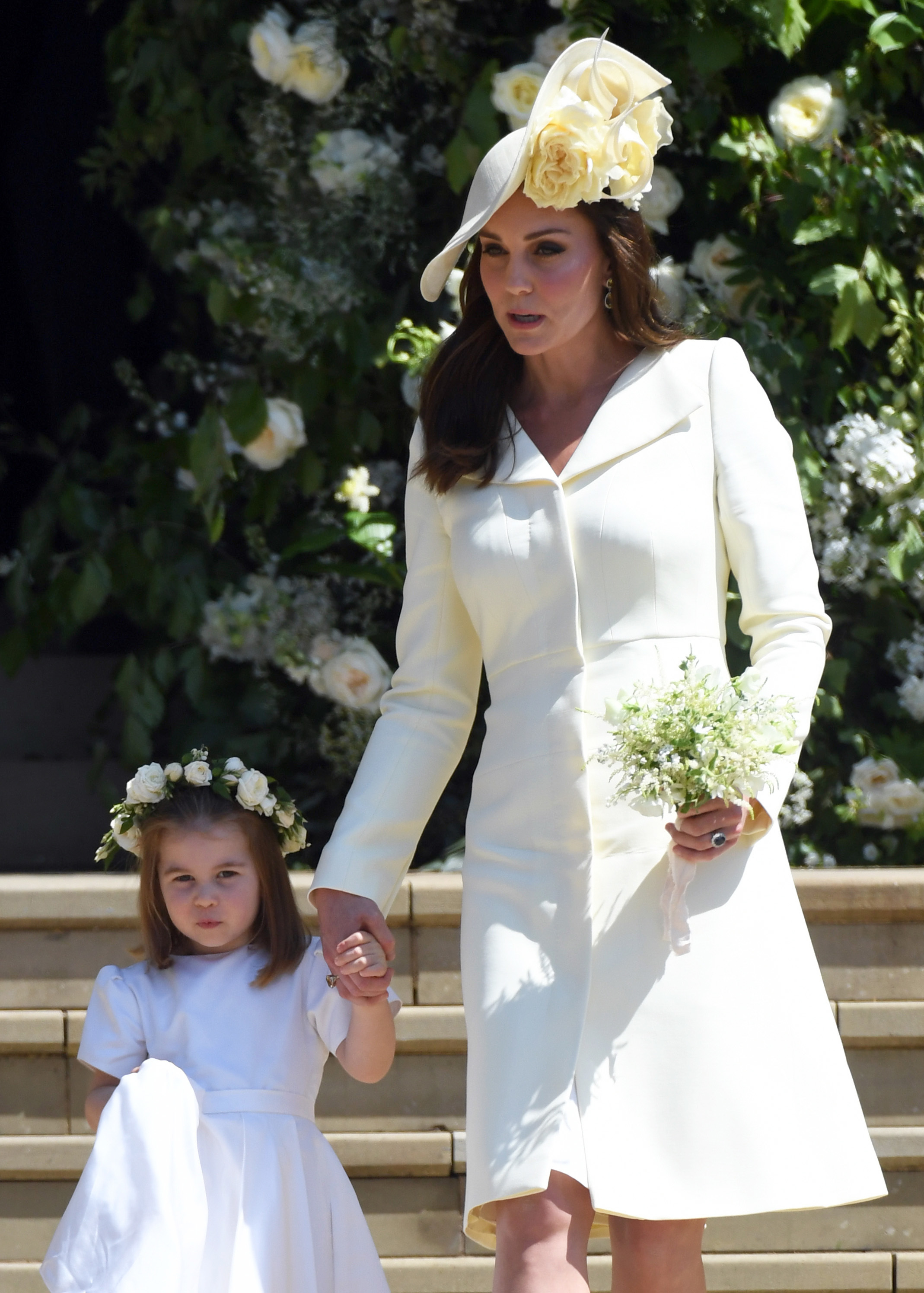 Duchess Kate and Princess Charlotte leave St George's Chapel in Windsor Castle after the royal wedding ceremony on May 19, 2018.