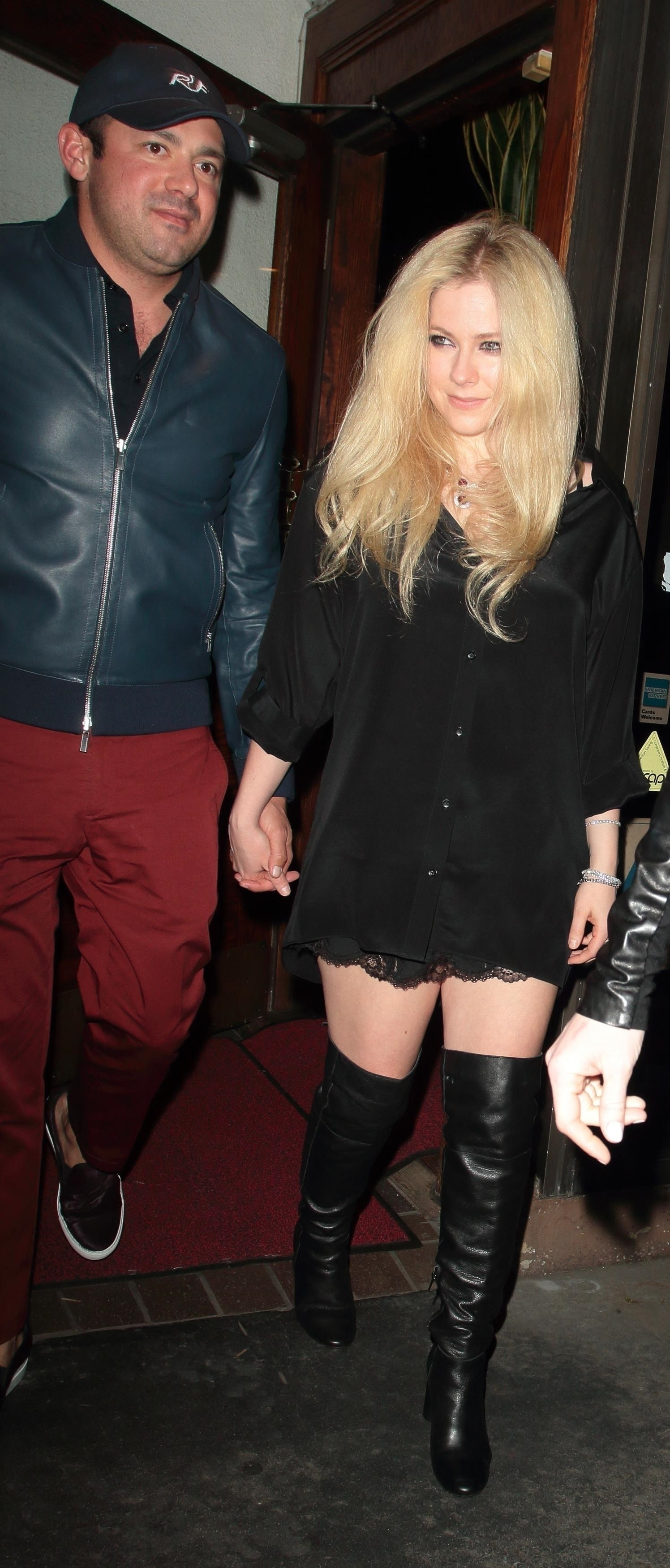 Avril Lavigne and billionaire boyfriend Phillip Sarofim look as serious as ever