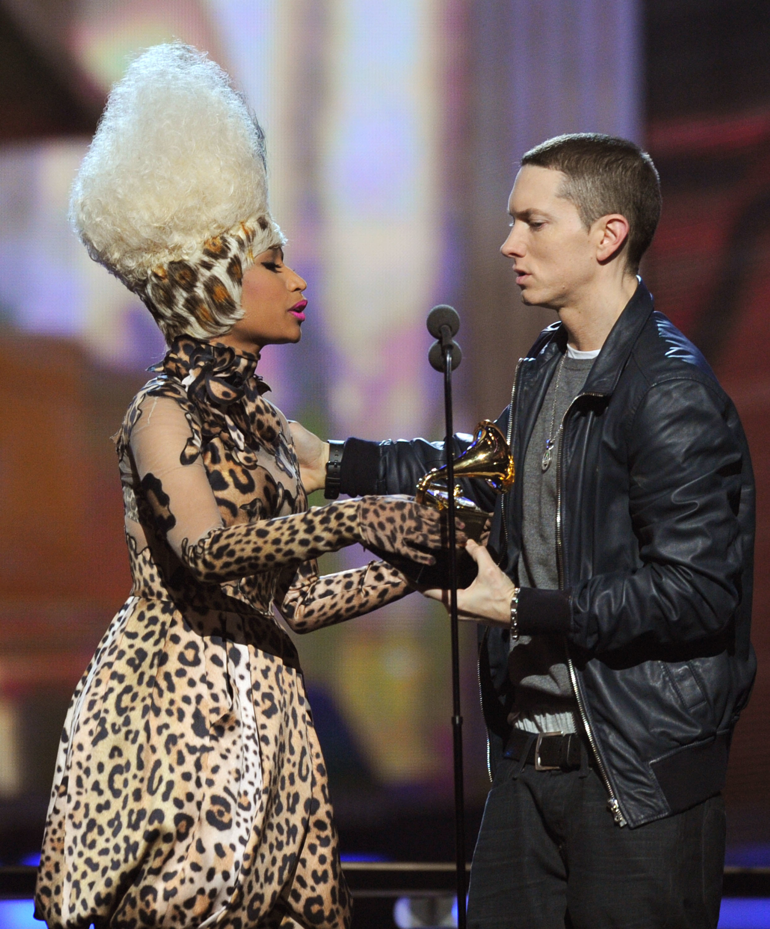"""Nicki Minaj presents Eminem with the best rap album award for """"Recovery"""" during the 53rd Annual Grammy Awards at the Staples Center in Los Angeles on Feb. 13, 2011."""