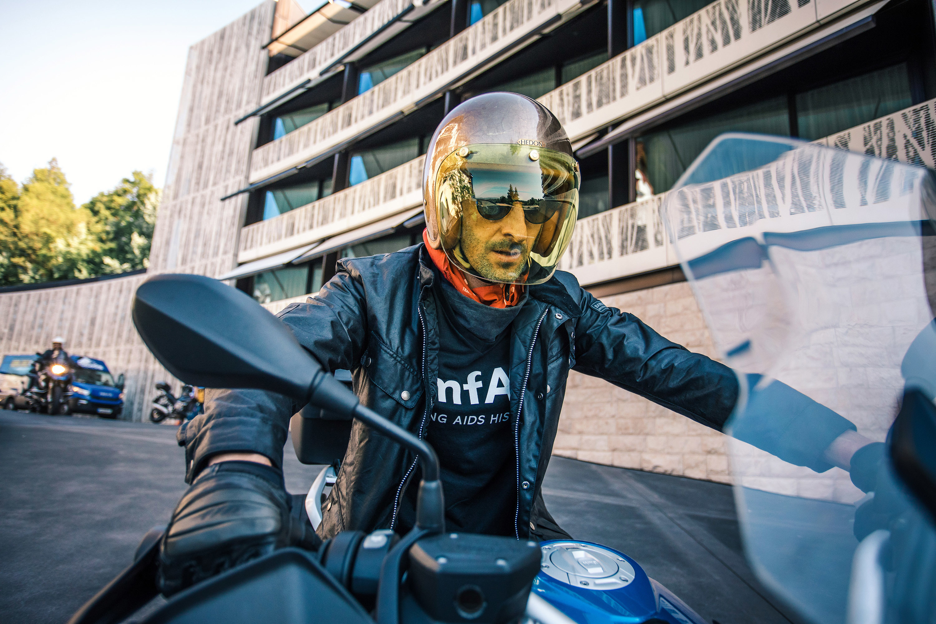 Adrien Brody sits on a motorbike during the press kick off and photo call for the 'amfAR Epic Ride to Life Ball' at Dolder Grand Hotel in Zurich, Switzerland, on May 30, 2018.