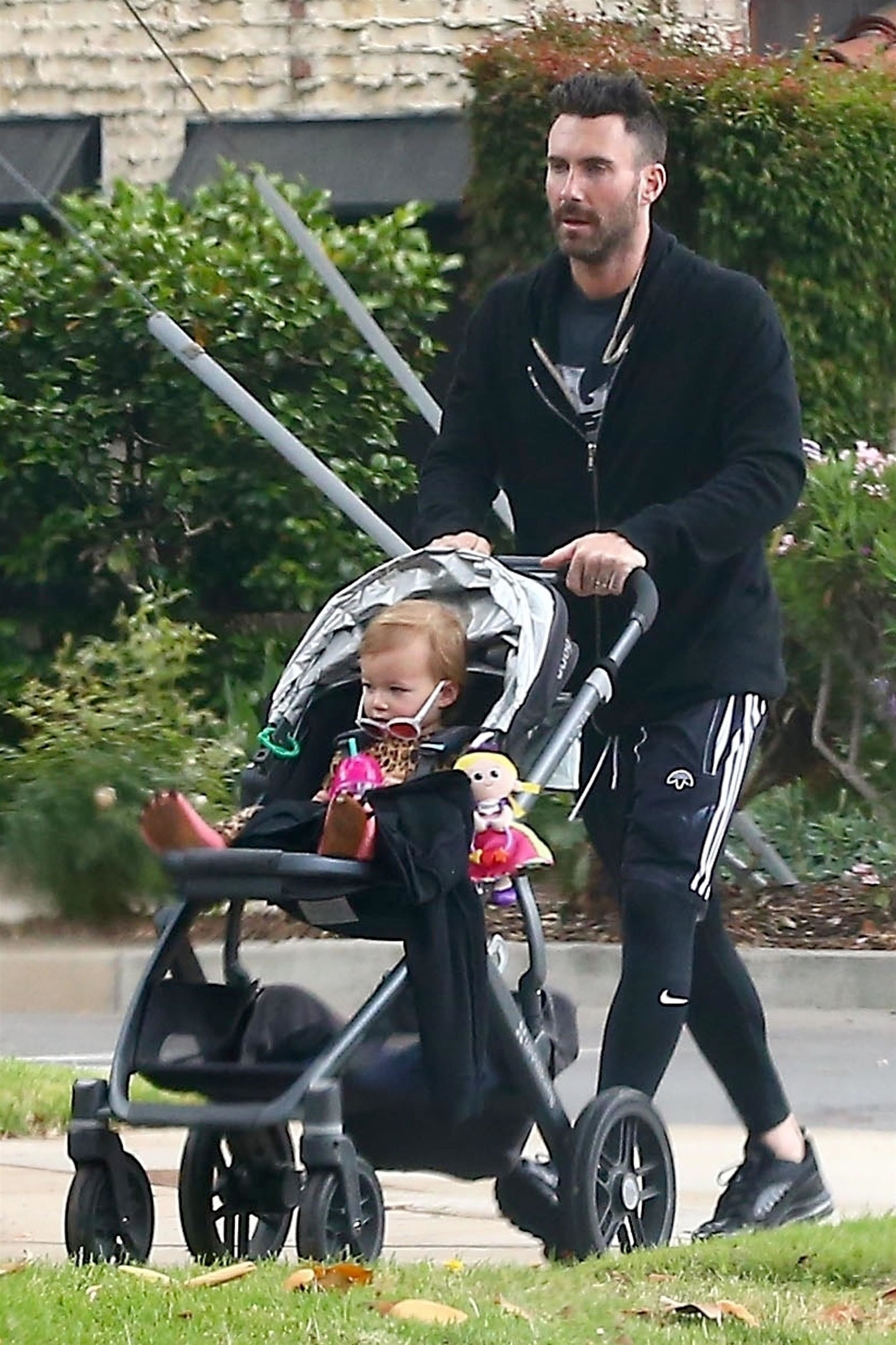 Adam Levine was spotted  taking his daughter Dusty Rose out for a stroll and a coffee run in Los Angeles on May 28, 2018.