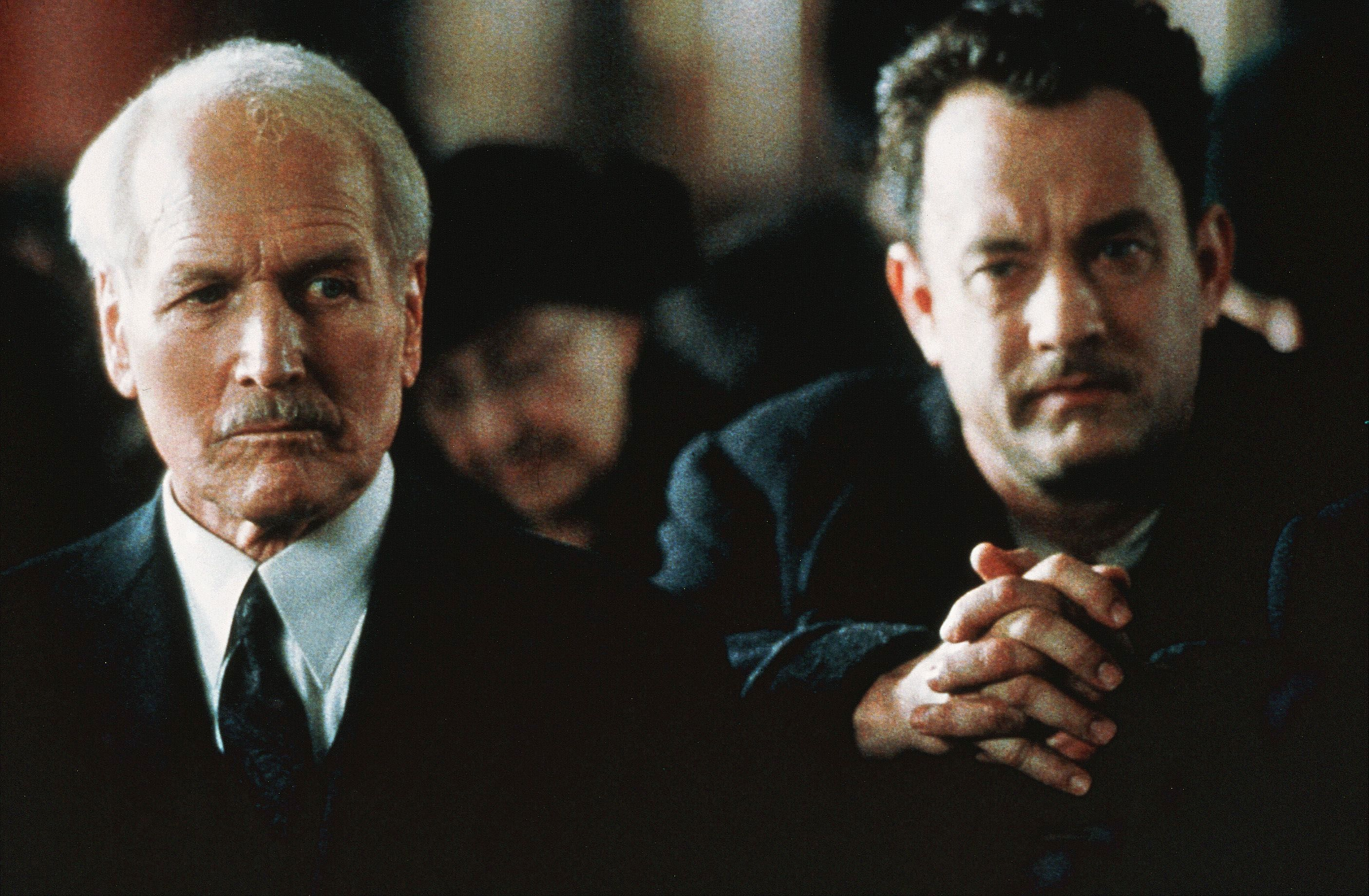 """Paul Newman and Tom Hanks are shown on the set of """"Road To Perdition"""" in 2002."""