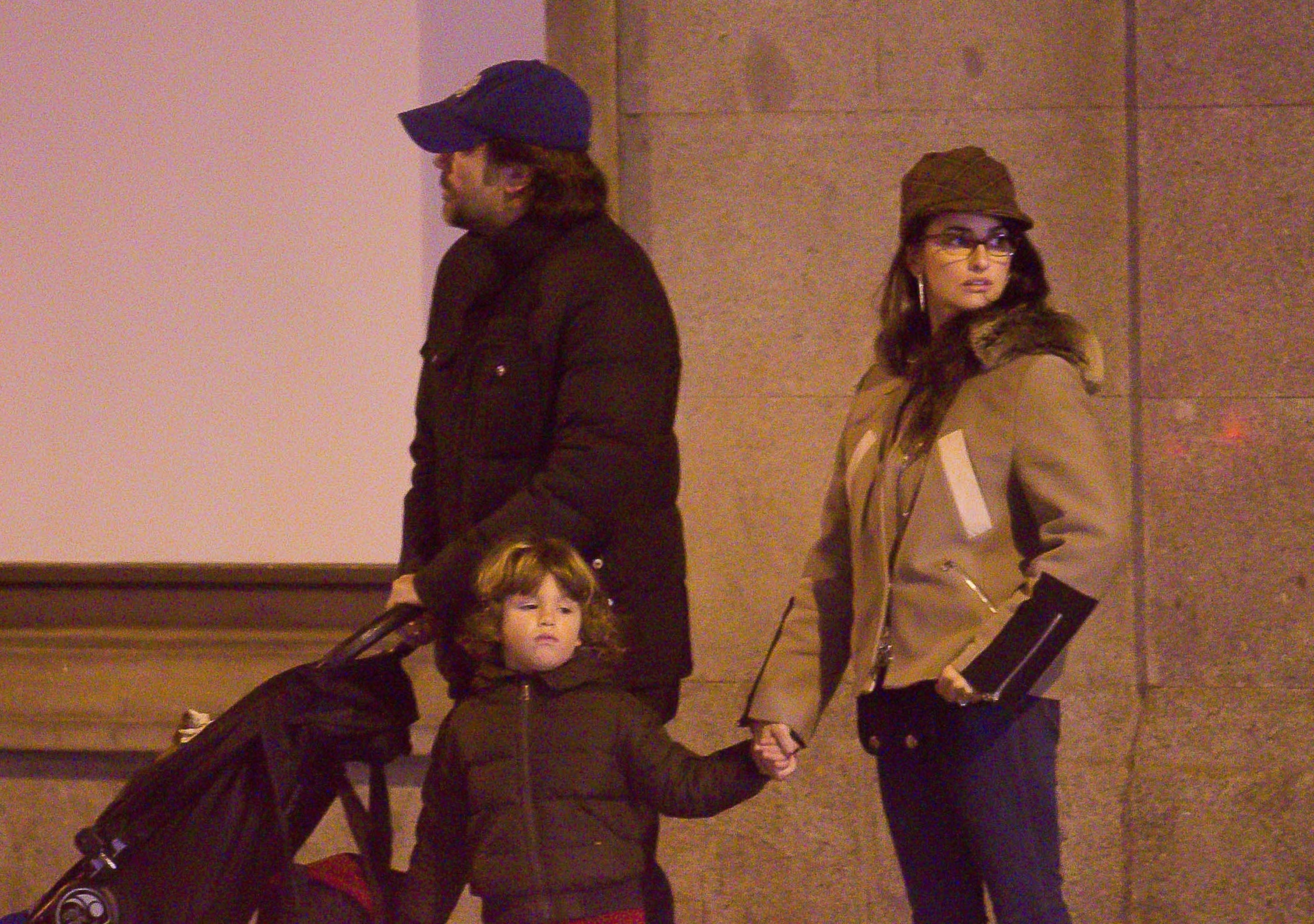 Javier Bardem and Penelope Cruz go for a walk with son Leo and daughter Luna in Madrid, Spain, on Dec. 26, 2014.