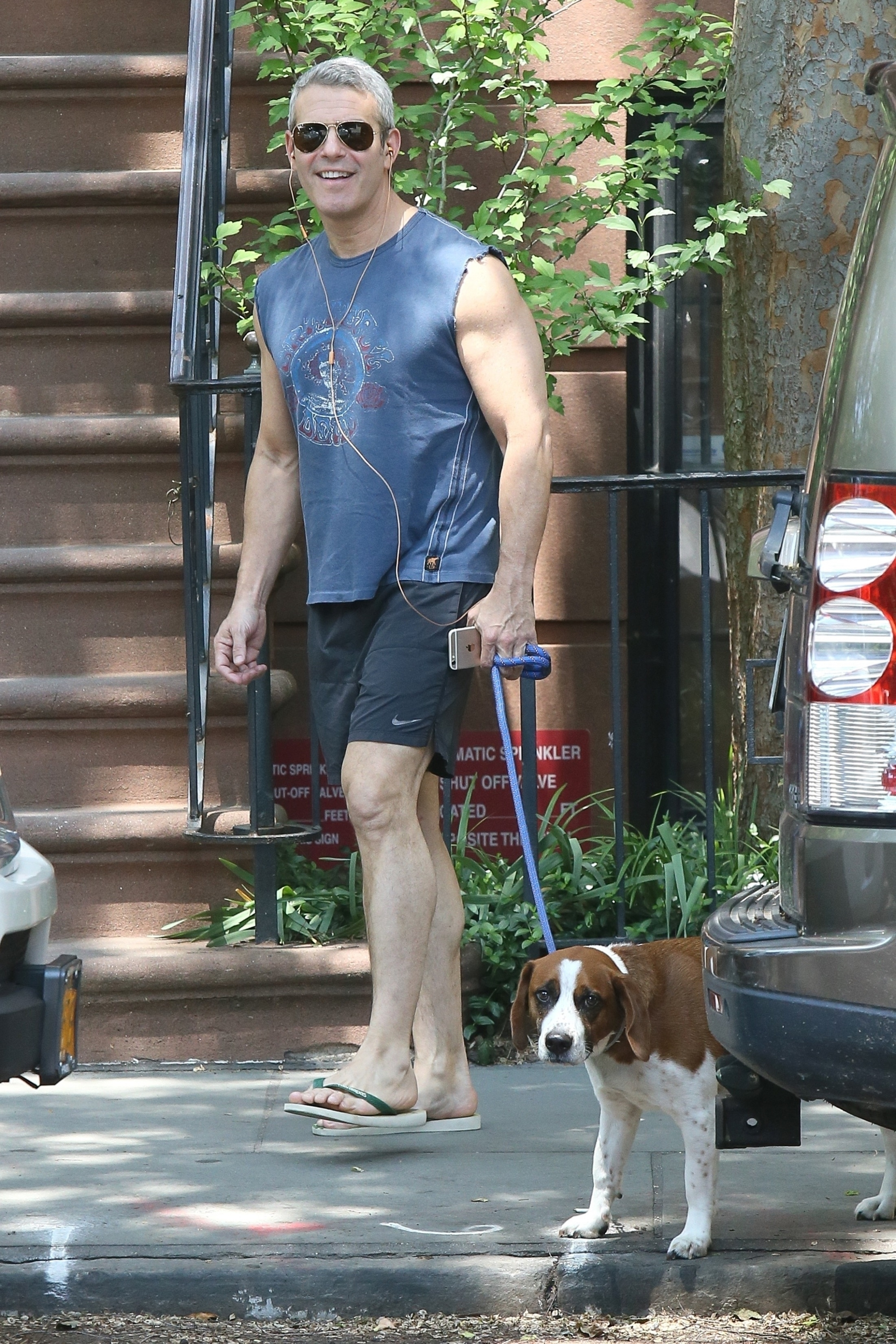 Andy Cohen took his dog Wacha for a walk while out in New York City on May 29, 2018.