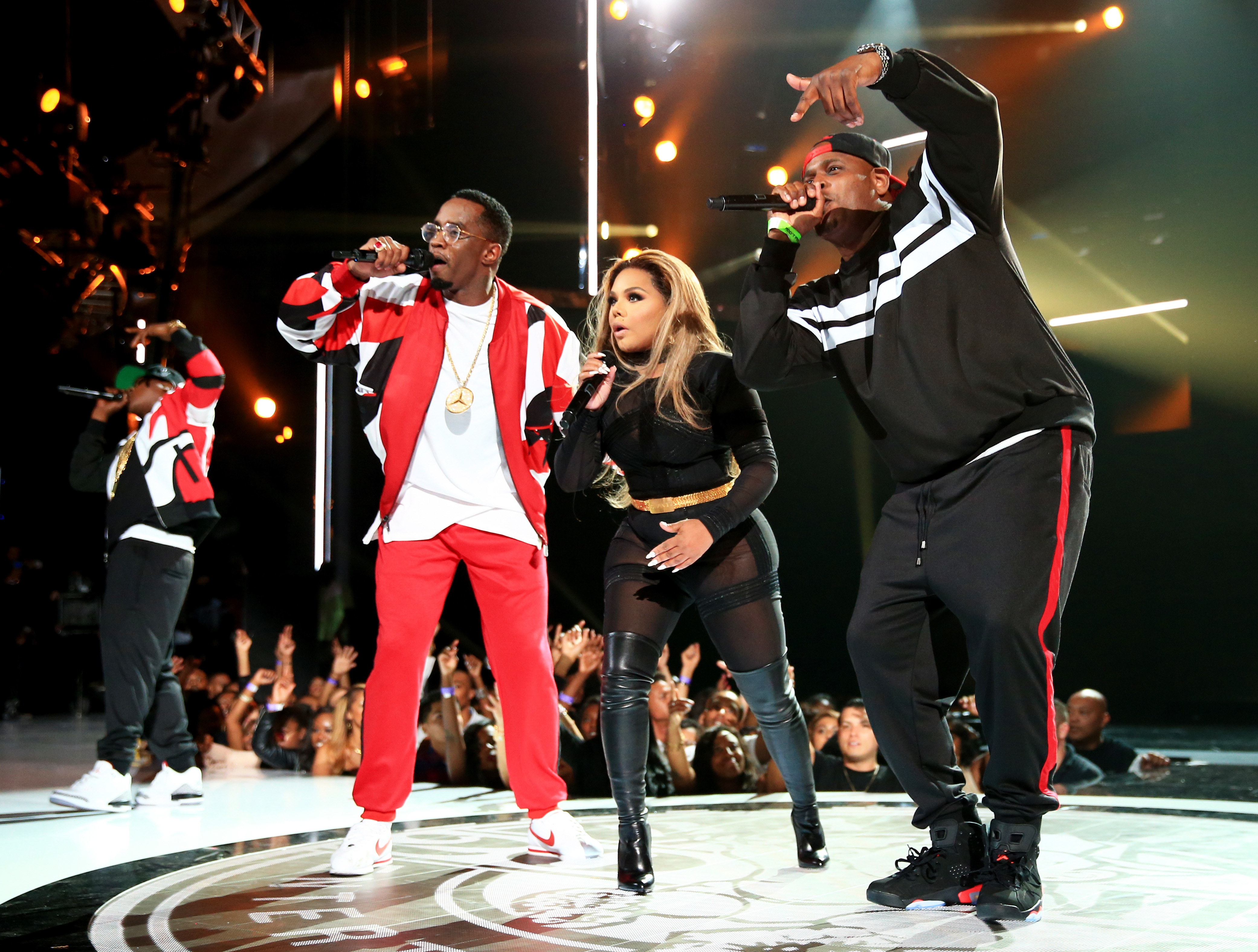 Sean 'Diddy' Combs, Lil' Kim and Sheek Louch of The Lox perform onstage during the 2015 BET Awards at the Microsoft Theater in Los Angeles on June 28, 2015.