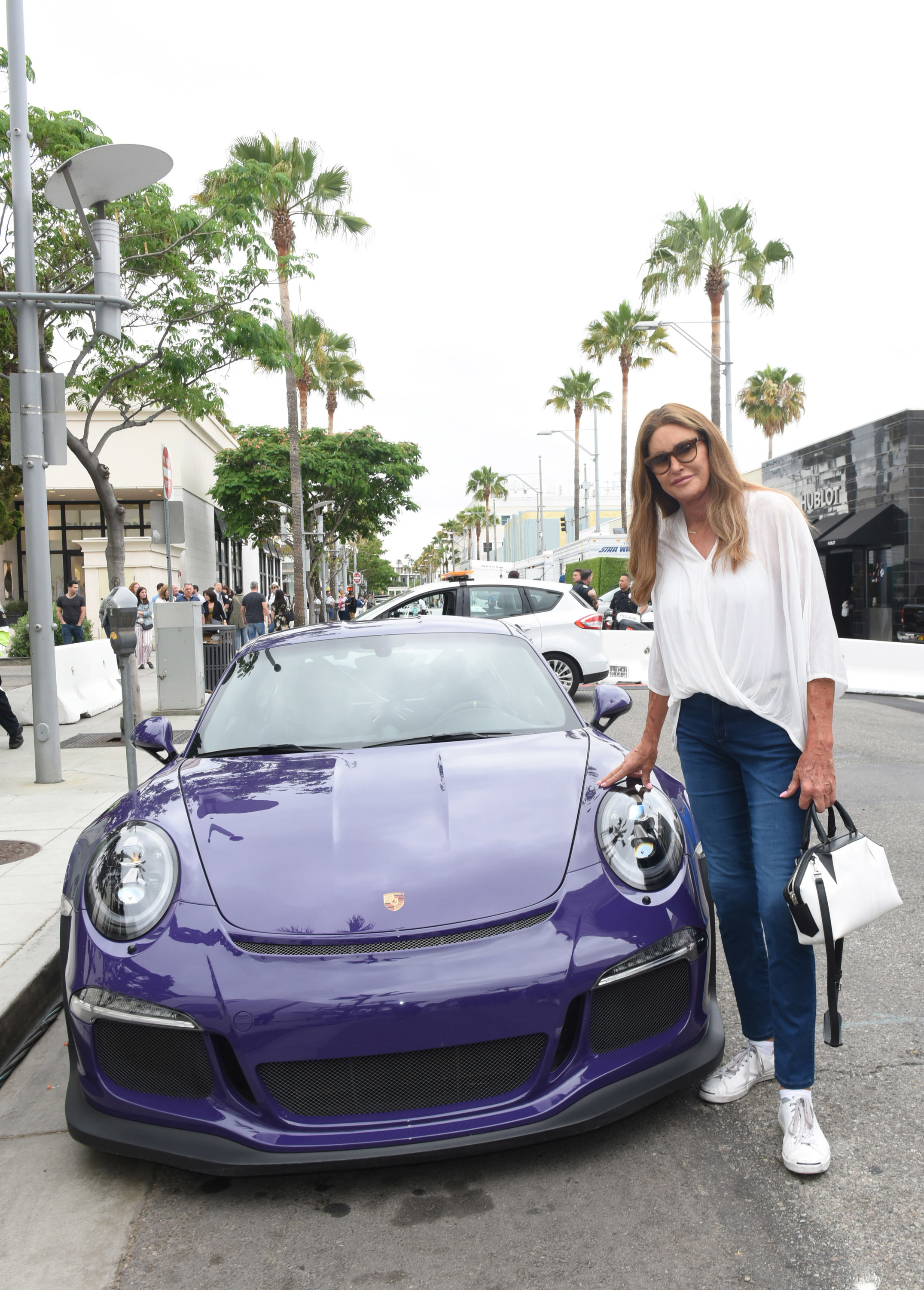 Caitlyn Jenner and her car at Rodeo Drive Concours d'Elegance Father's Day Car Show in Beverly Hills, California,  on June 17, 2018.
