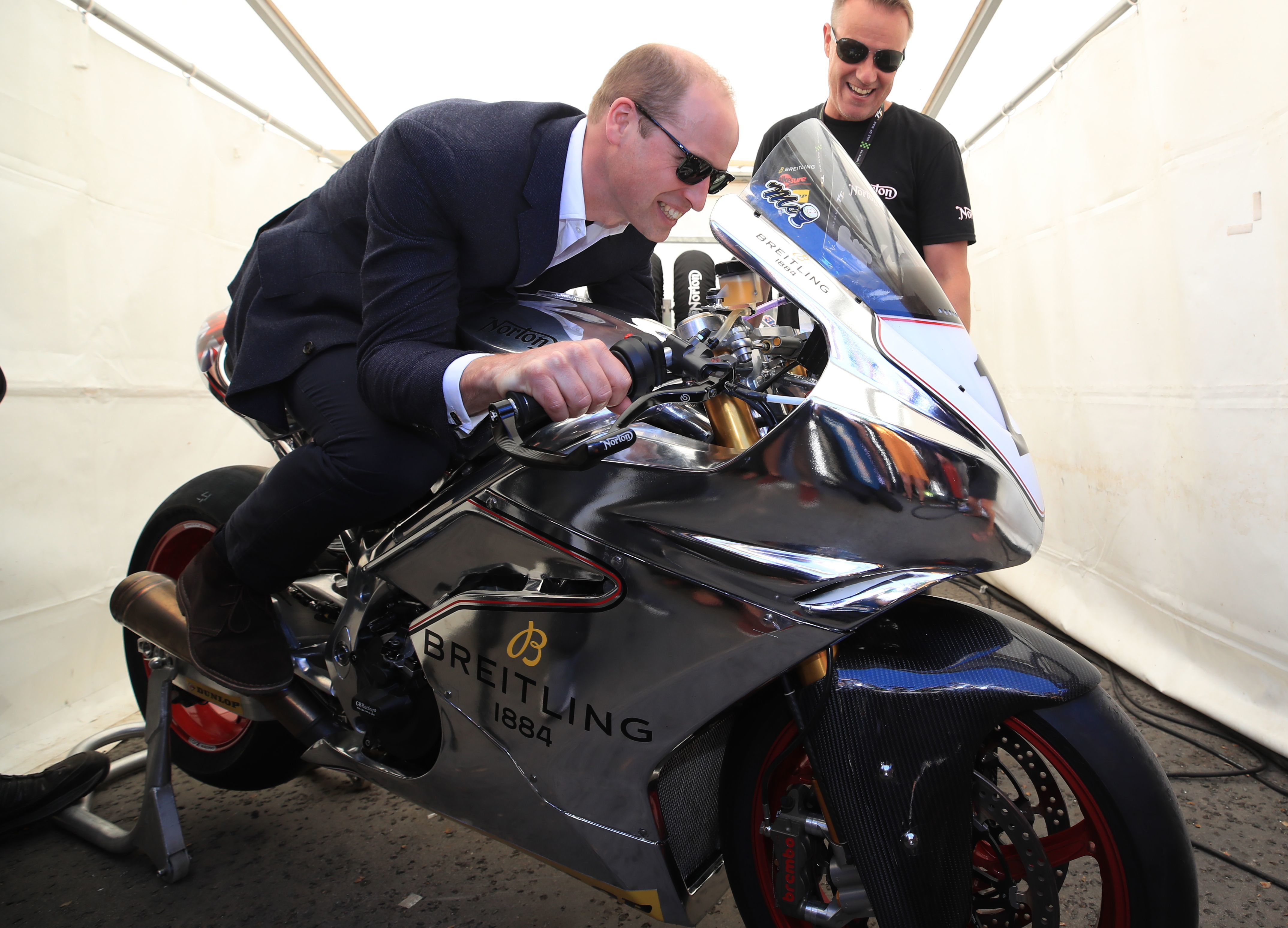 Prince William tries out a motorbike at the Isle of Man TT during his visit to the island on June 6, 2018.