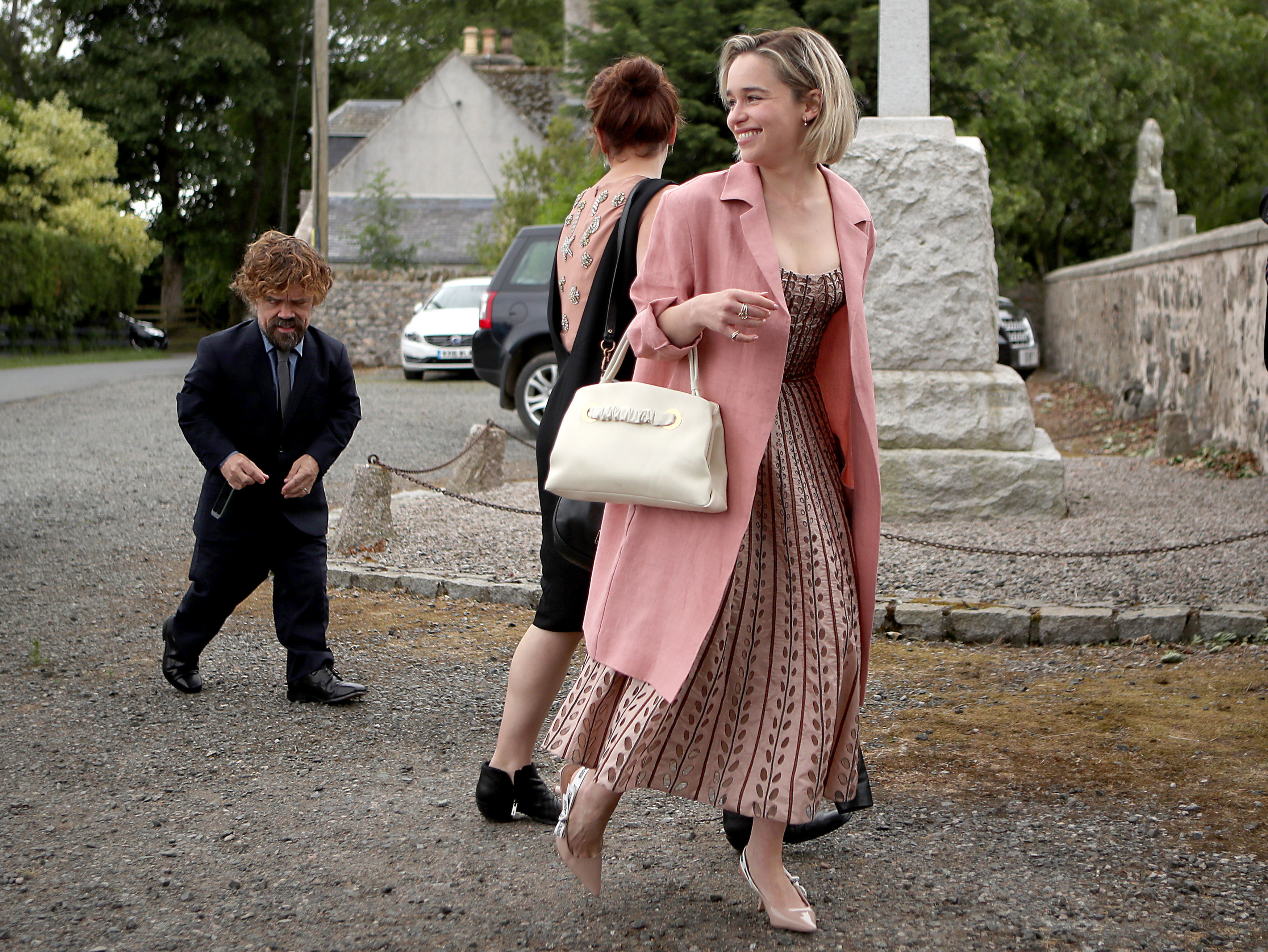 Actors Peter Dinklage and Emilia Clarke arrive at Rayne Church, Kirkton of Rayne in Aberdeenshire, for the wedding ceremony of their Game Of Thrones co stars Kit Harington and Rose Leslie on June 23, 2018.