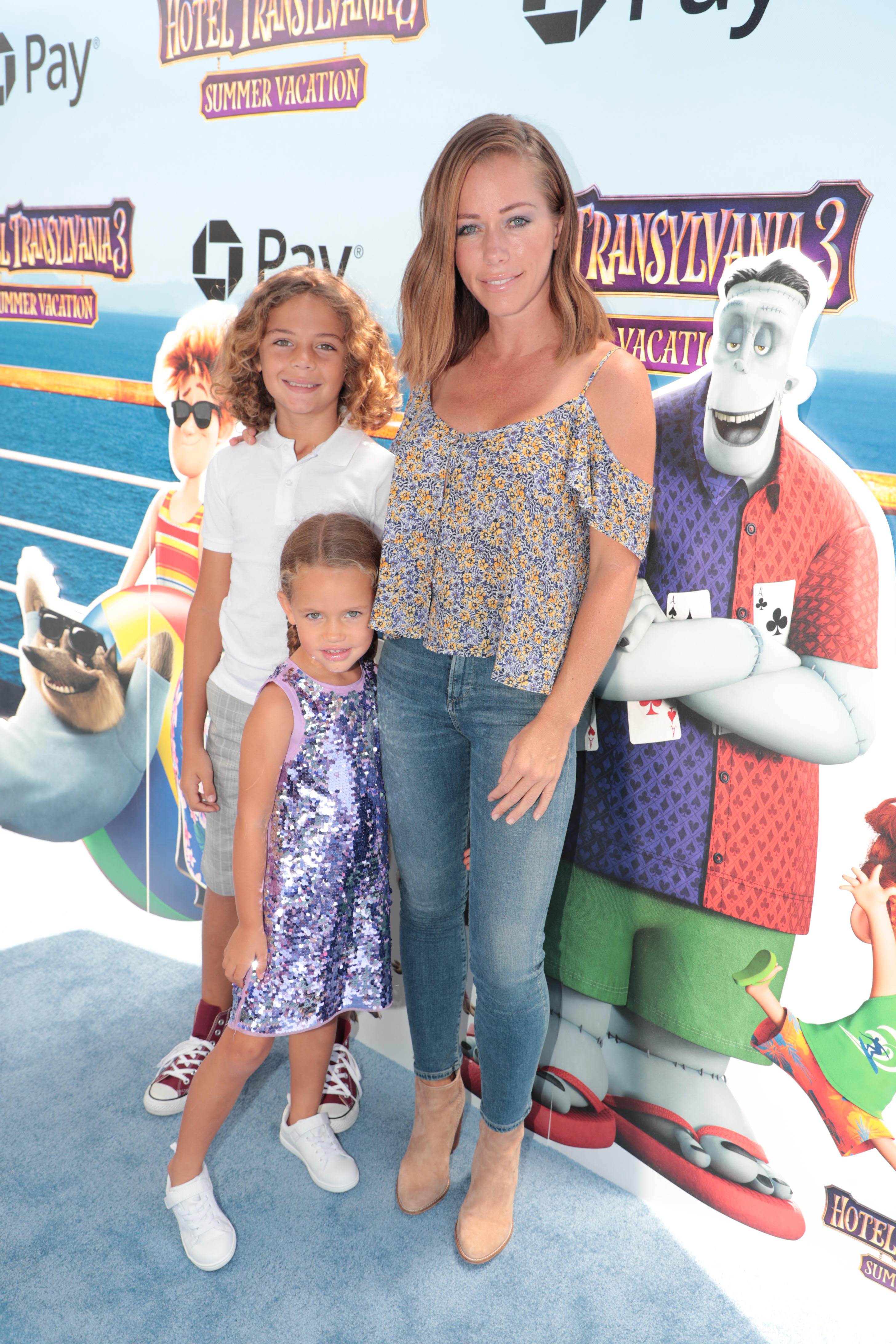 "Hank Baskett Jnr, Alijah Baskett and Kendra Wilkinson attend the premiere of ""Hotel Transylvania 3: Summer Vacation"" in Los Angeles on June 30, 2018."