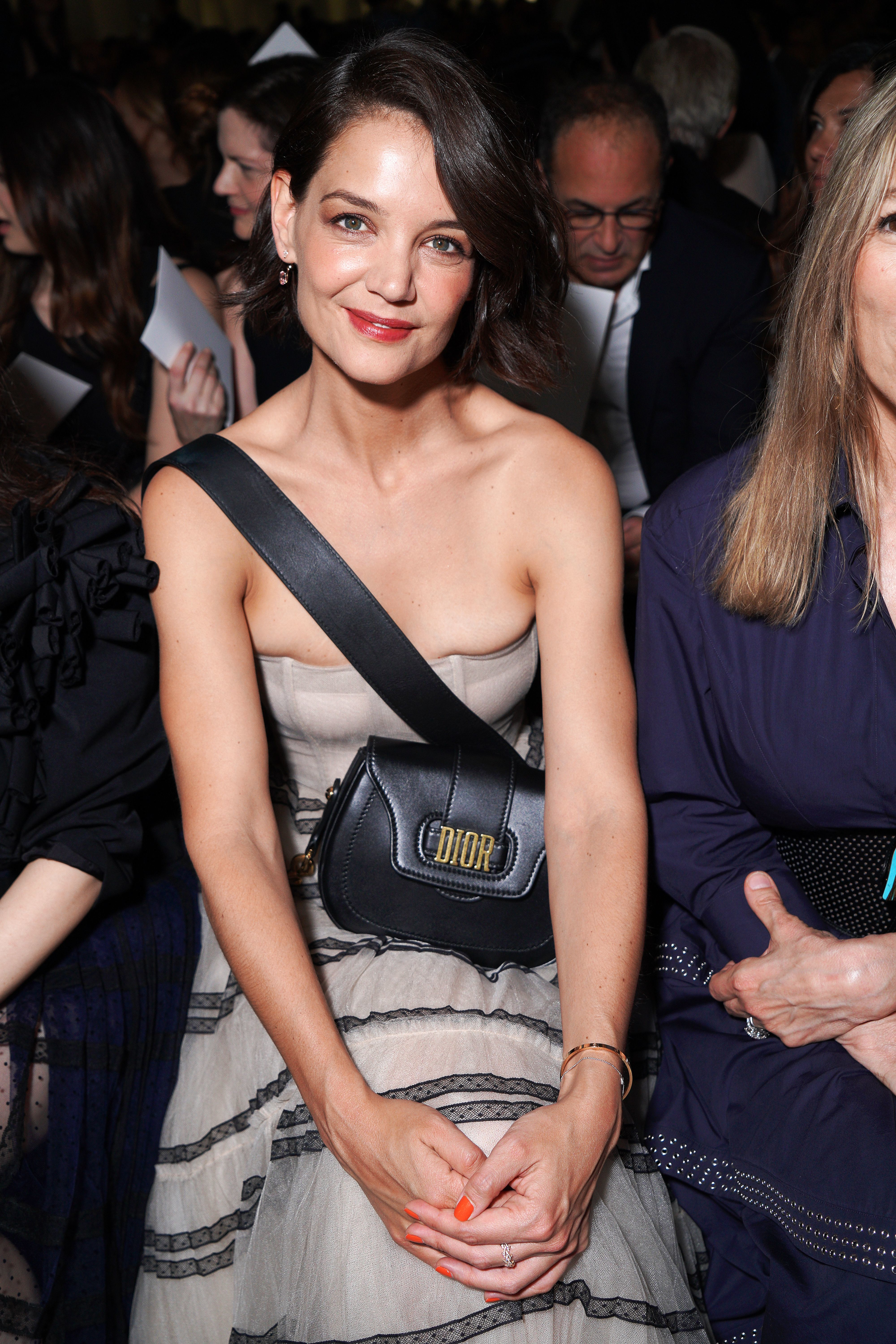 Katie Holmes appears in the front row of the Christian Dior show for Fall/Winter 2018 at Haute Couture Fashion Week on July 2, 2018.