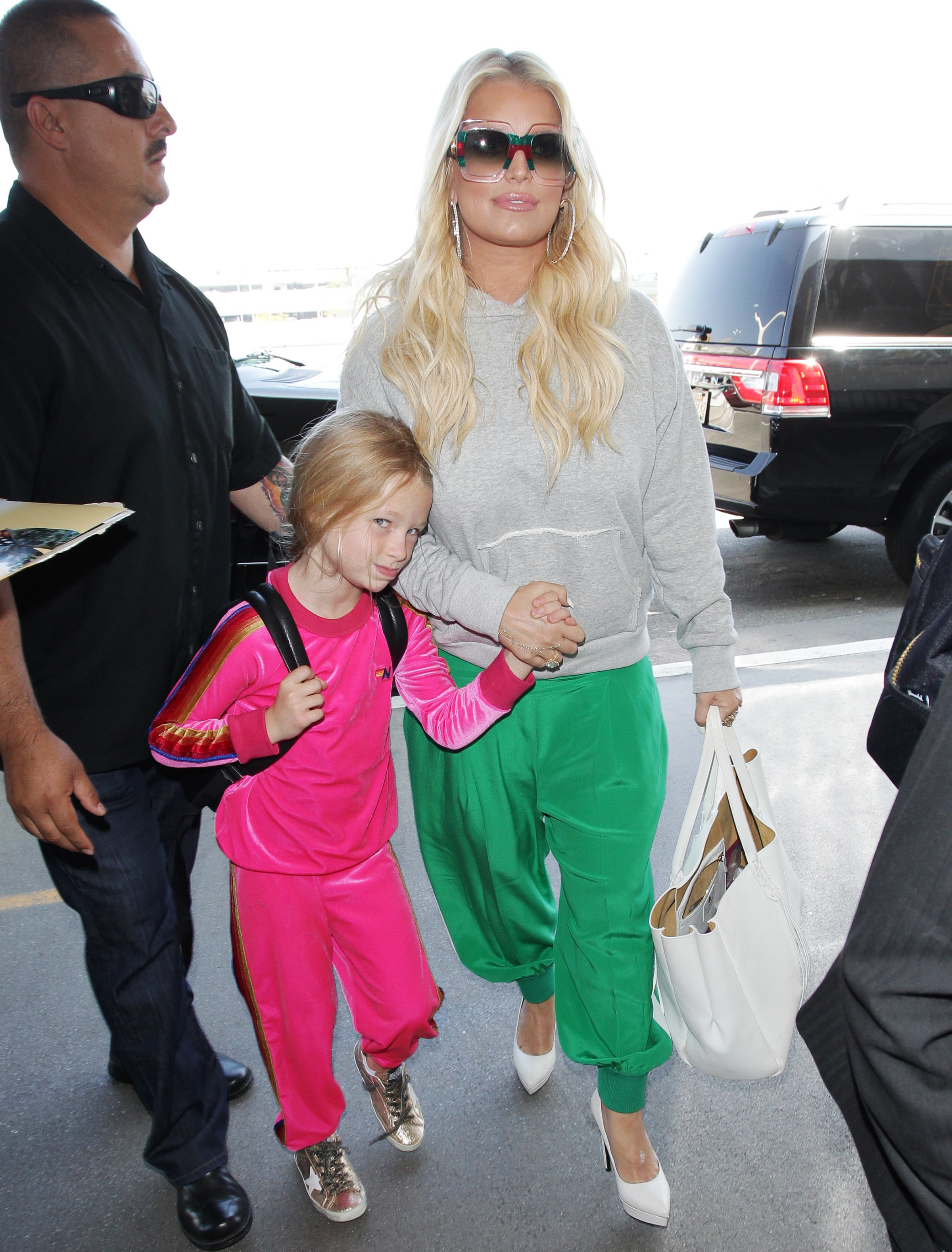 Jessica Simpson and Maxwell Drew Johnson arrive at LAX Airport in Los Angeles on May 9, 2018.