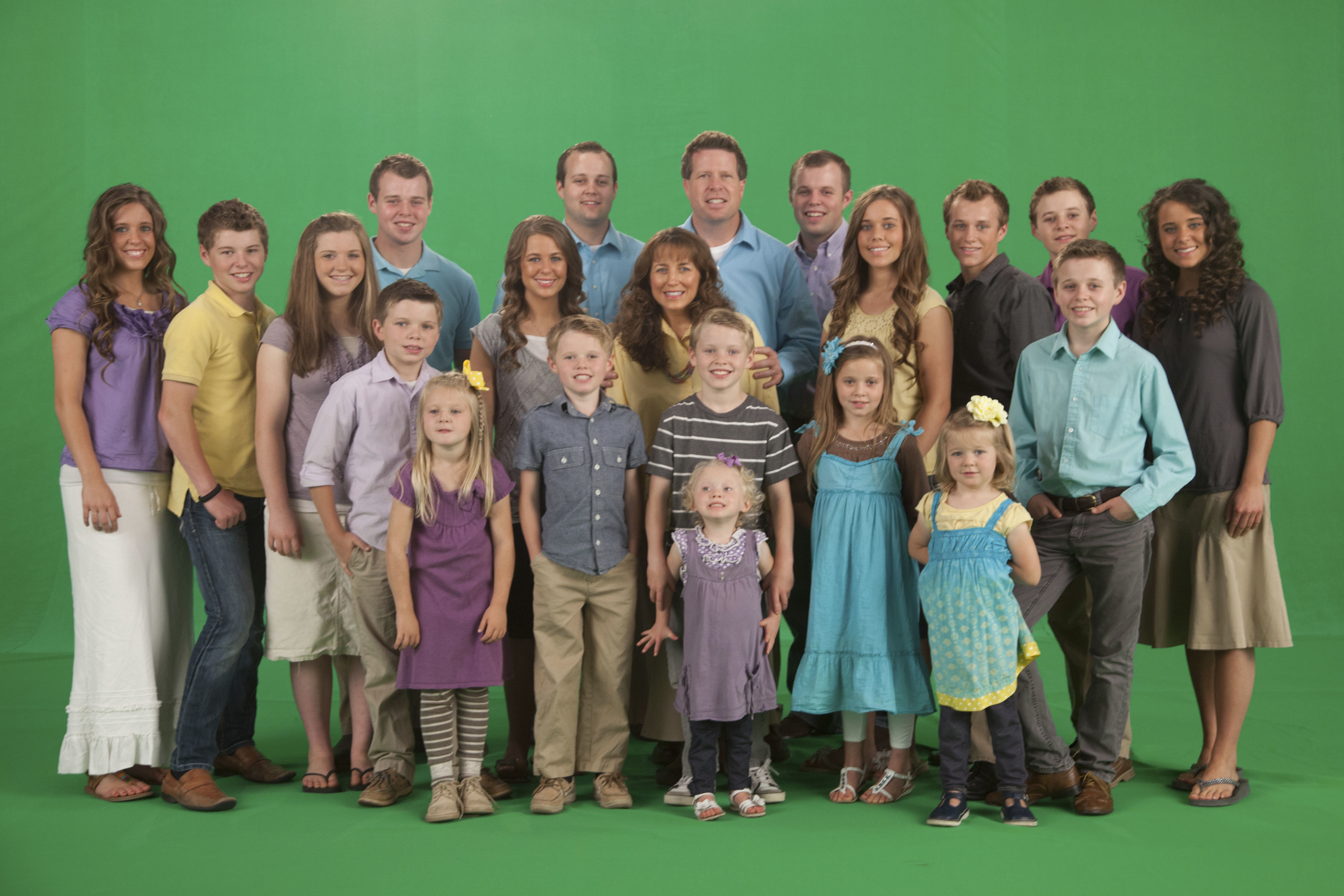 """The Duggar family poses in a promotional photo for TLC's """"19 Kids and Counting."""""""
