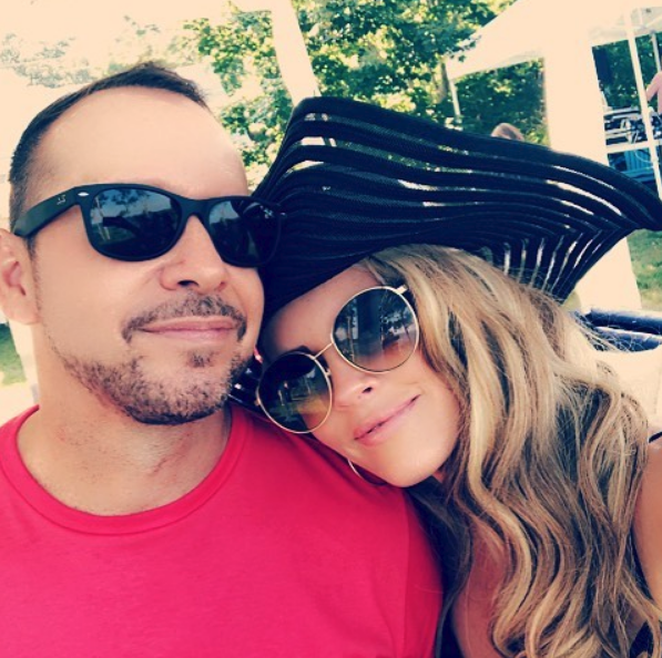 """Happy 4th to all my favorite peeps!""   Jenny McCarthy, who posted this selfie with her man, Donnie Wahlberg, on Instagram on July 4, 2018."