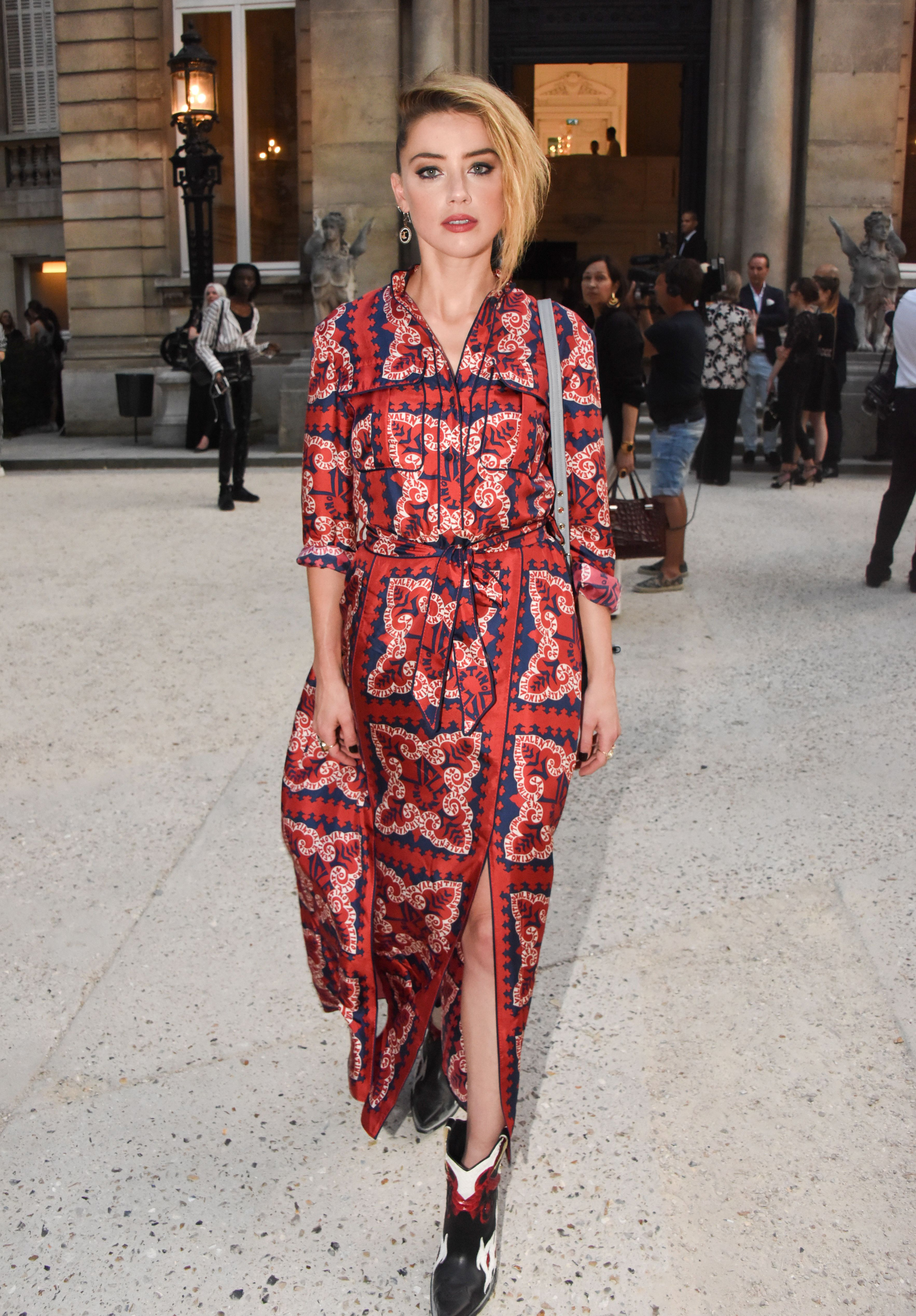 Amber Heard attends the Valentino show for Haute Couture Fashion Week in Paris on July 4, 2018.