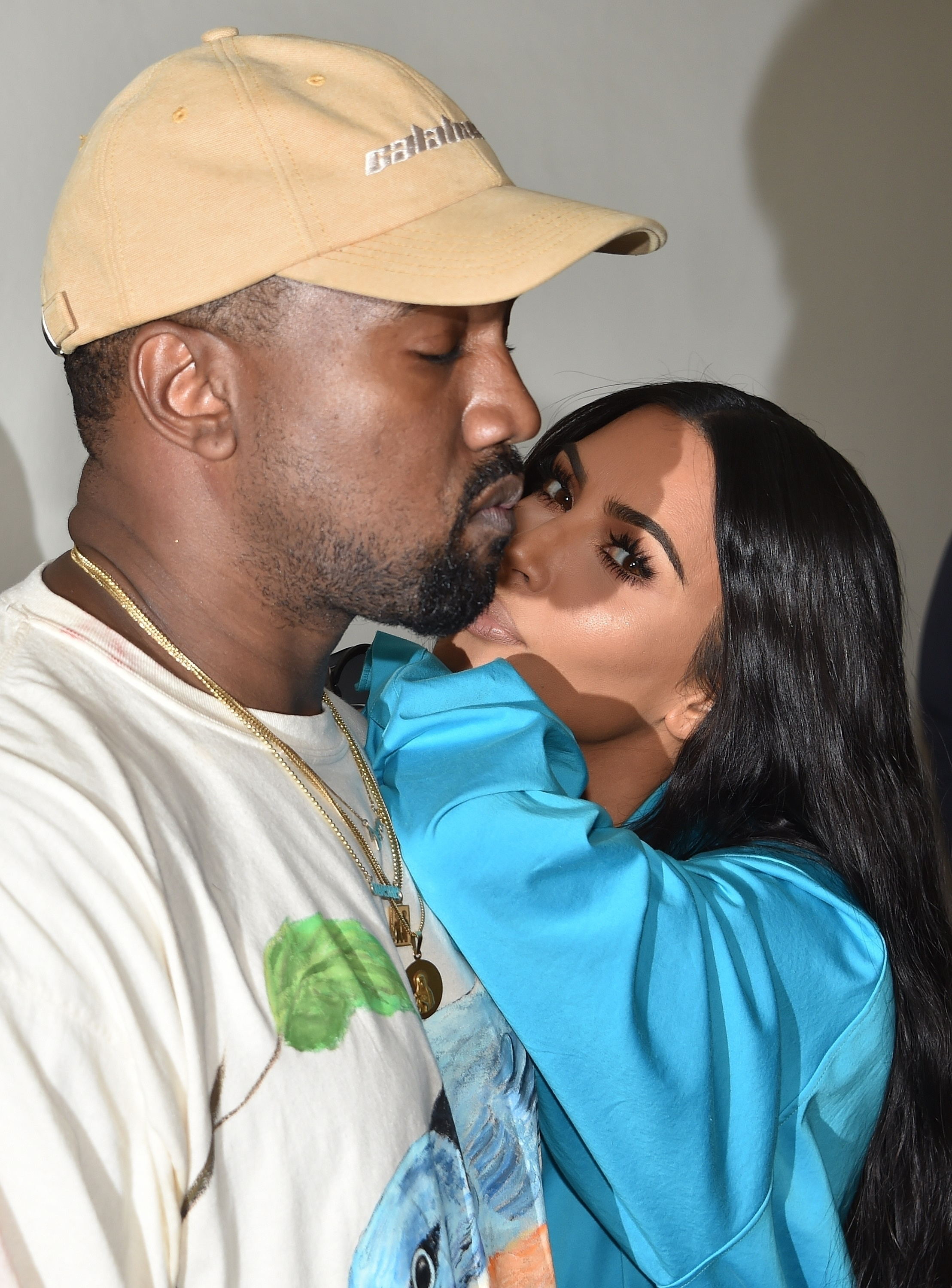 Kim Kardashian West couldn't keep her hands off husband Kanye West at the Louis Vuitton fashion show in Paris on June 21, 2018.