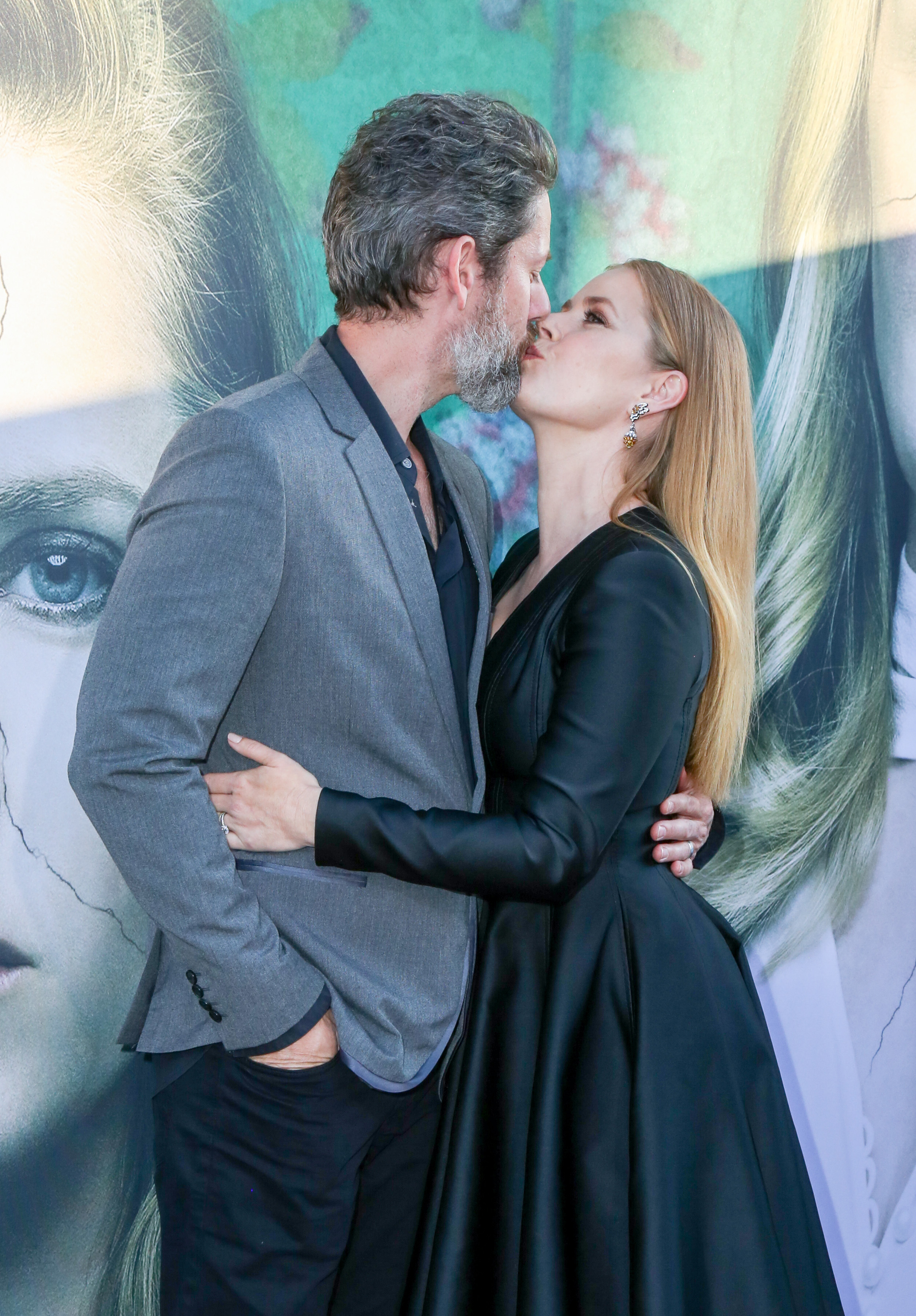 """Amy Adams planted a big kiss on her husband, Darren Le Gallo, while attending the premiere of her new HBO miniseries """"Sharp Objects"""" in Los Angeles on July 3, 2018."""
