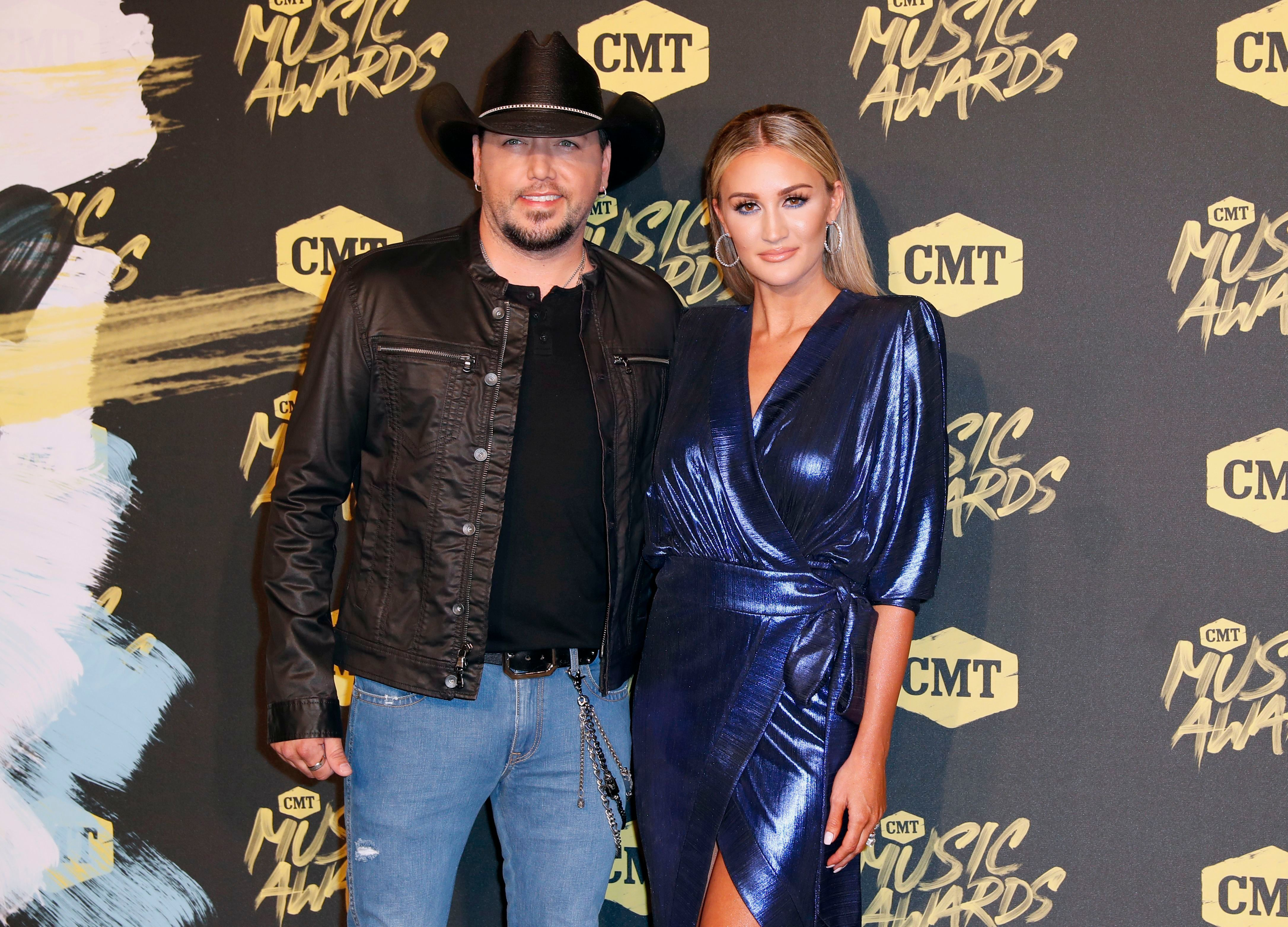 Jason Aldean and wife Brittany Kerr arrive at the CMT Music Awards at the Bridgestone Arena in Nashville on June 6, 2018.