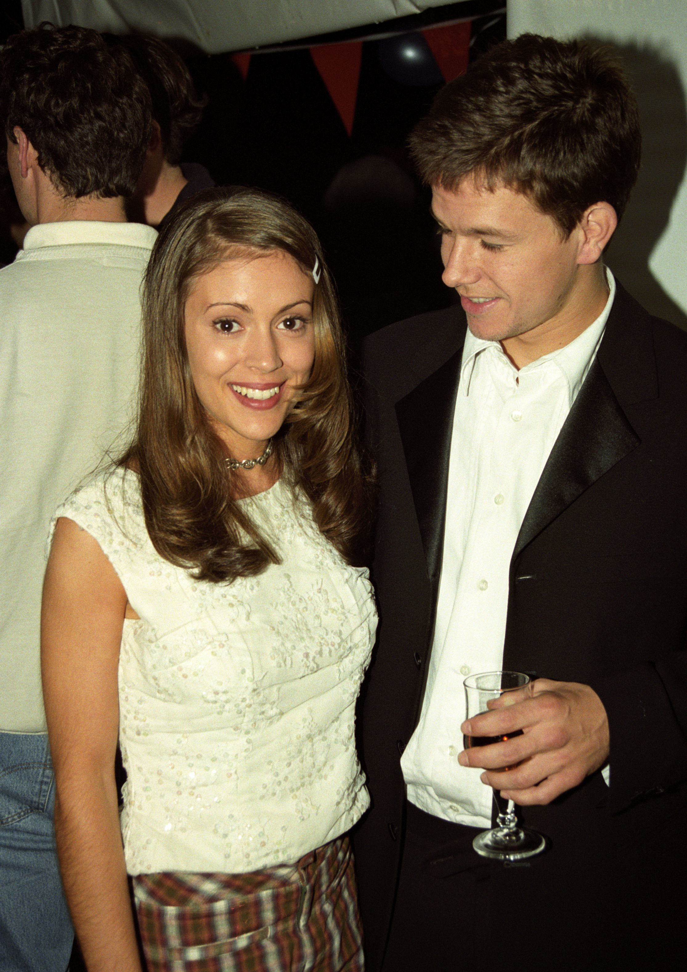 """Alyssa Milano and Mark Wahlberg attend the premiere of """"Fear"""" at the Cannes Film Festival in France on May 9, 1996."""