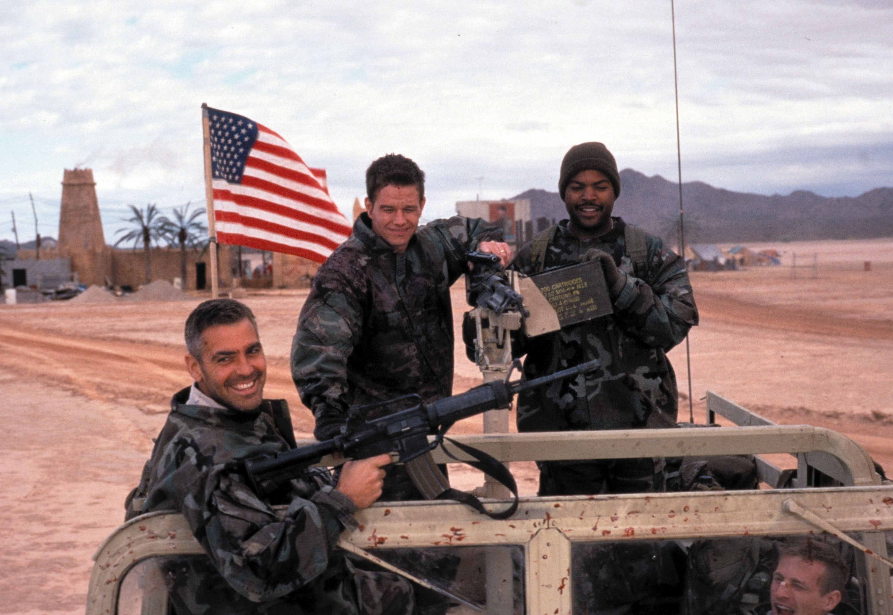 """George Clooney, Mark Wahlberg and Ice Cube in """"Three Kings"""" in 1999."""