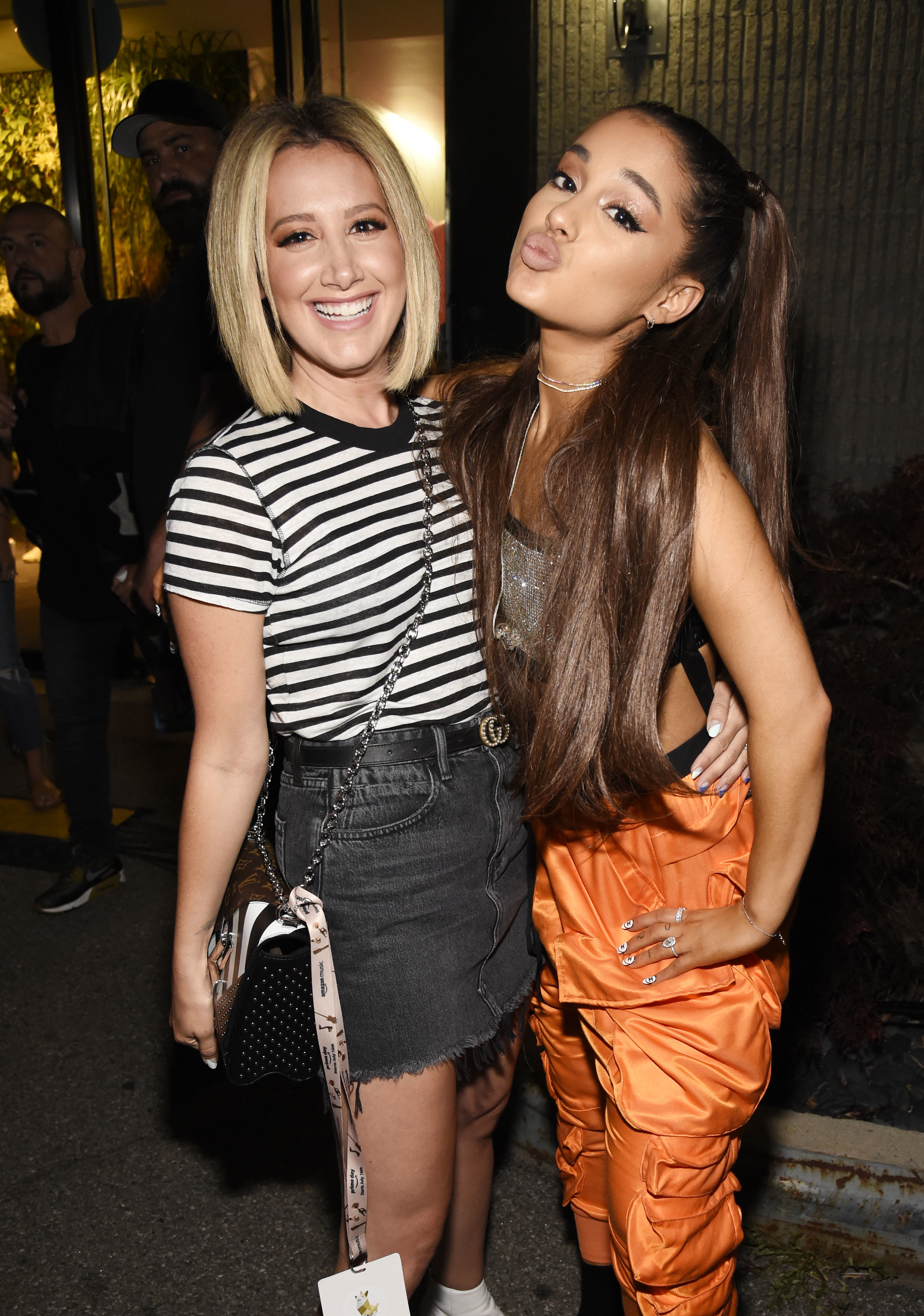 Ashley Tisdale and Ariana Grande pose backstage at the Amazon Music Unboxing Prime Day event in Brooklyn in New York on July 11, 2018.