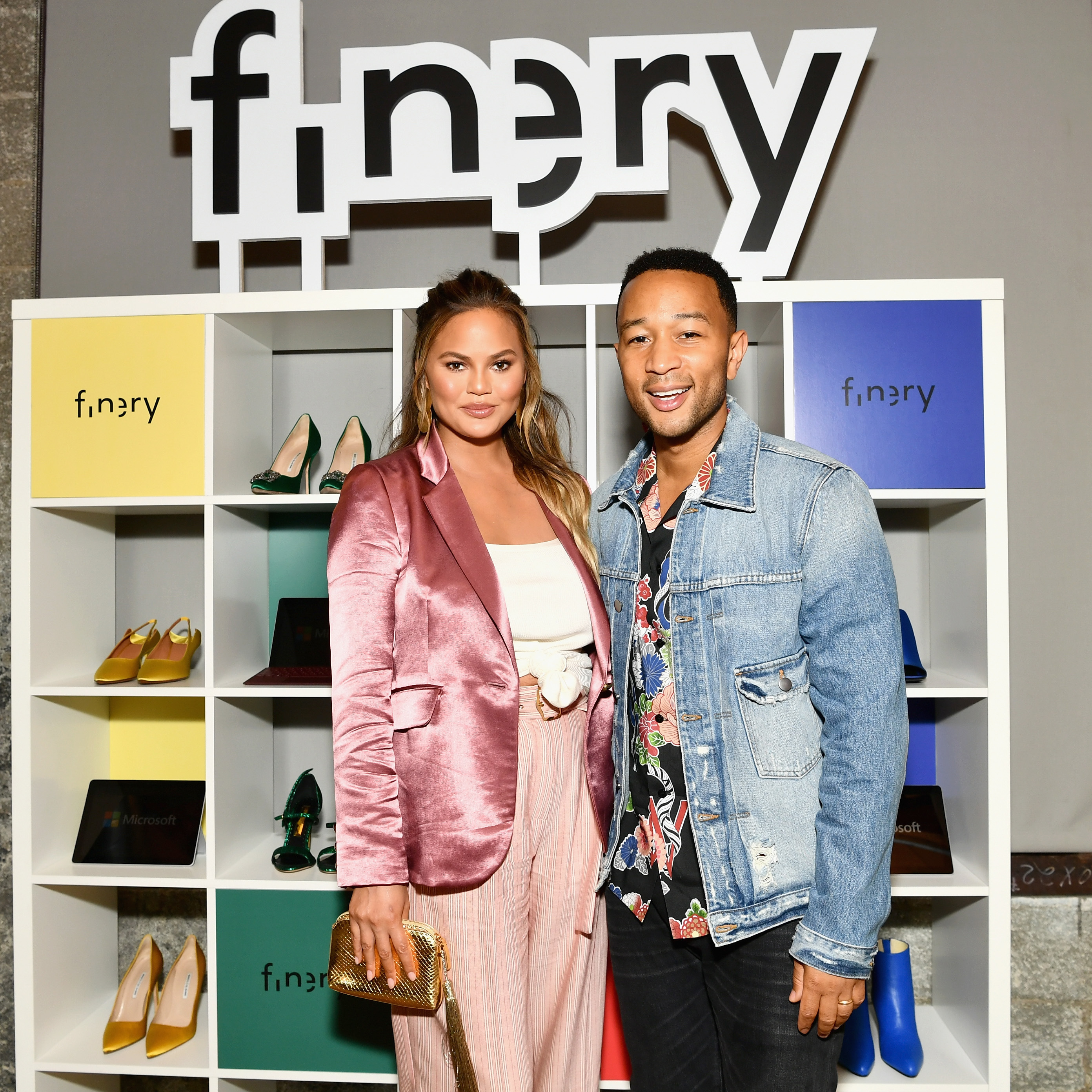 Chrissy Teigen and John Legend attend the Finery App launch party hosted by Brooklyn Decker at Microsoft Lounge in Culver City, California, on July 11, 2018.