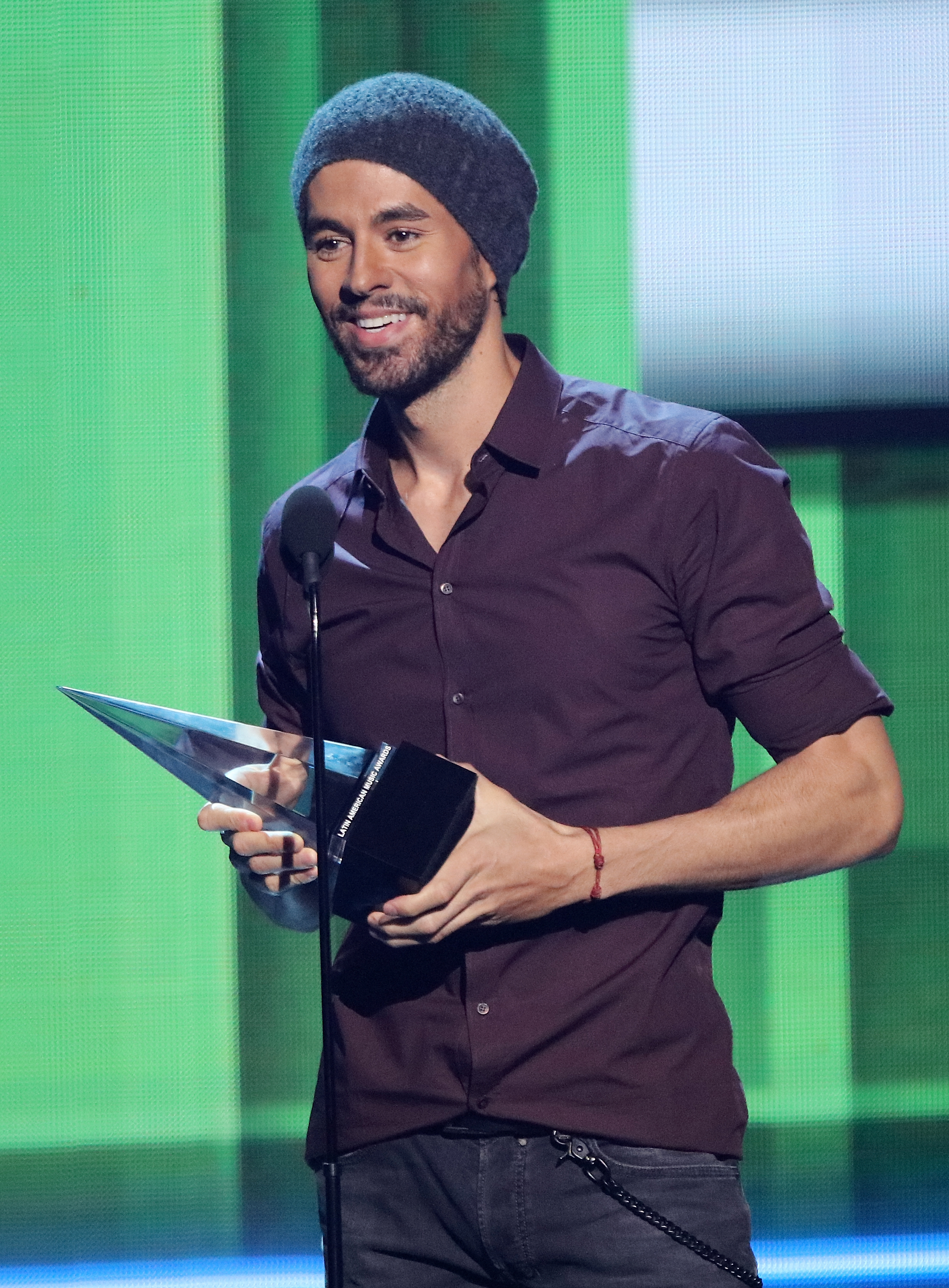 Enrique Iglesias accepts the 'Artist Of The Year' award during the 2017 Latin American Music Awards at Dolby Theatre in Hollywood, California on Oct. 26, 2017.