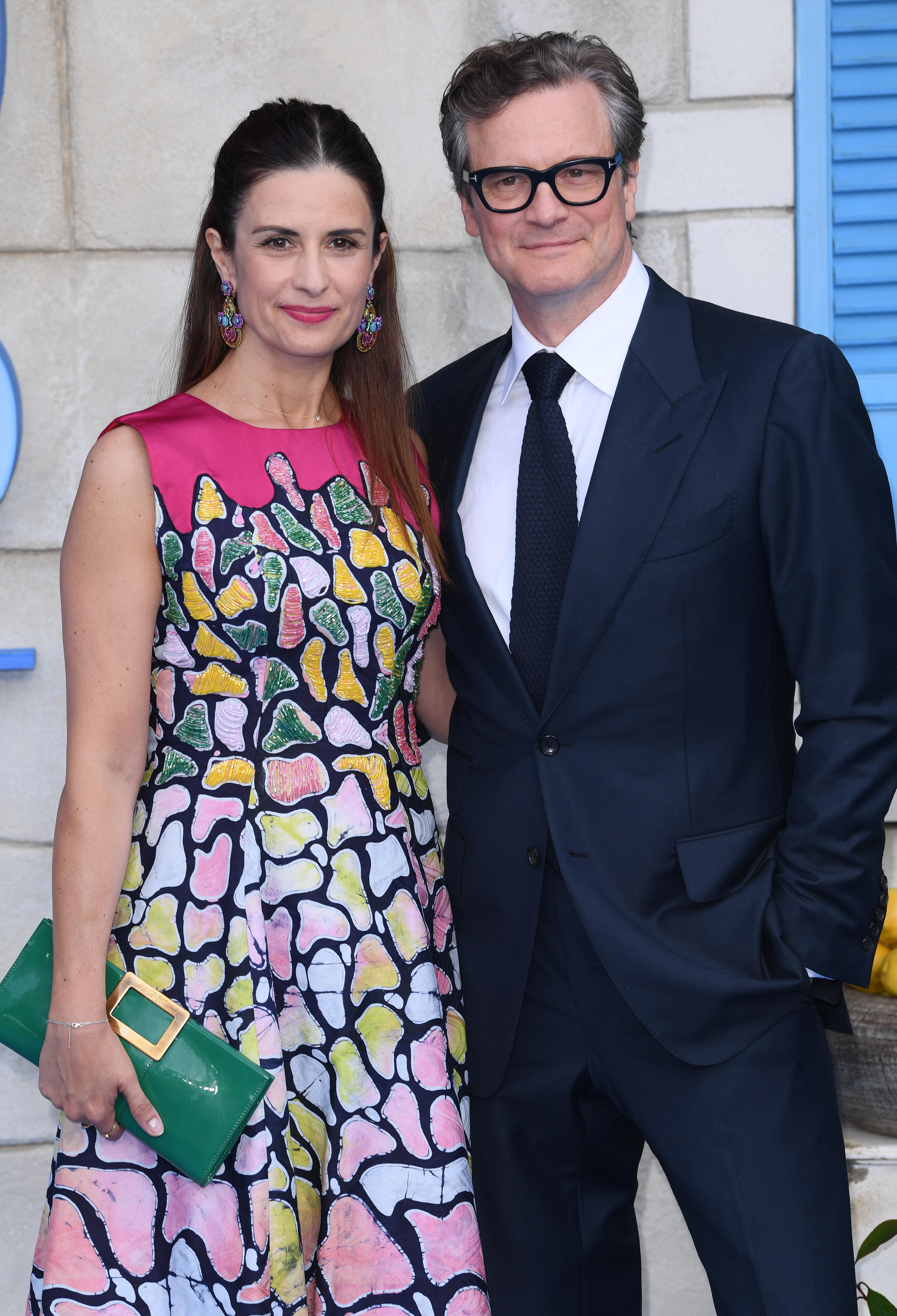"""Colin Firth and Livia Giuggioli attend the """"Mamma Mia! Here We Go Again"""" film premiere in London on July 16, 2018."""