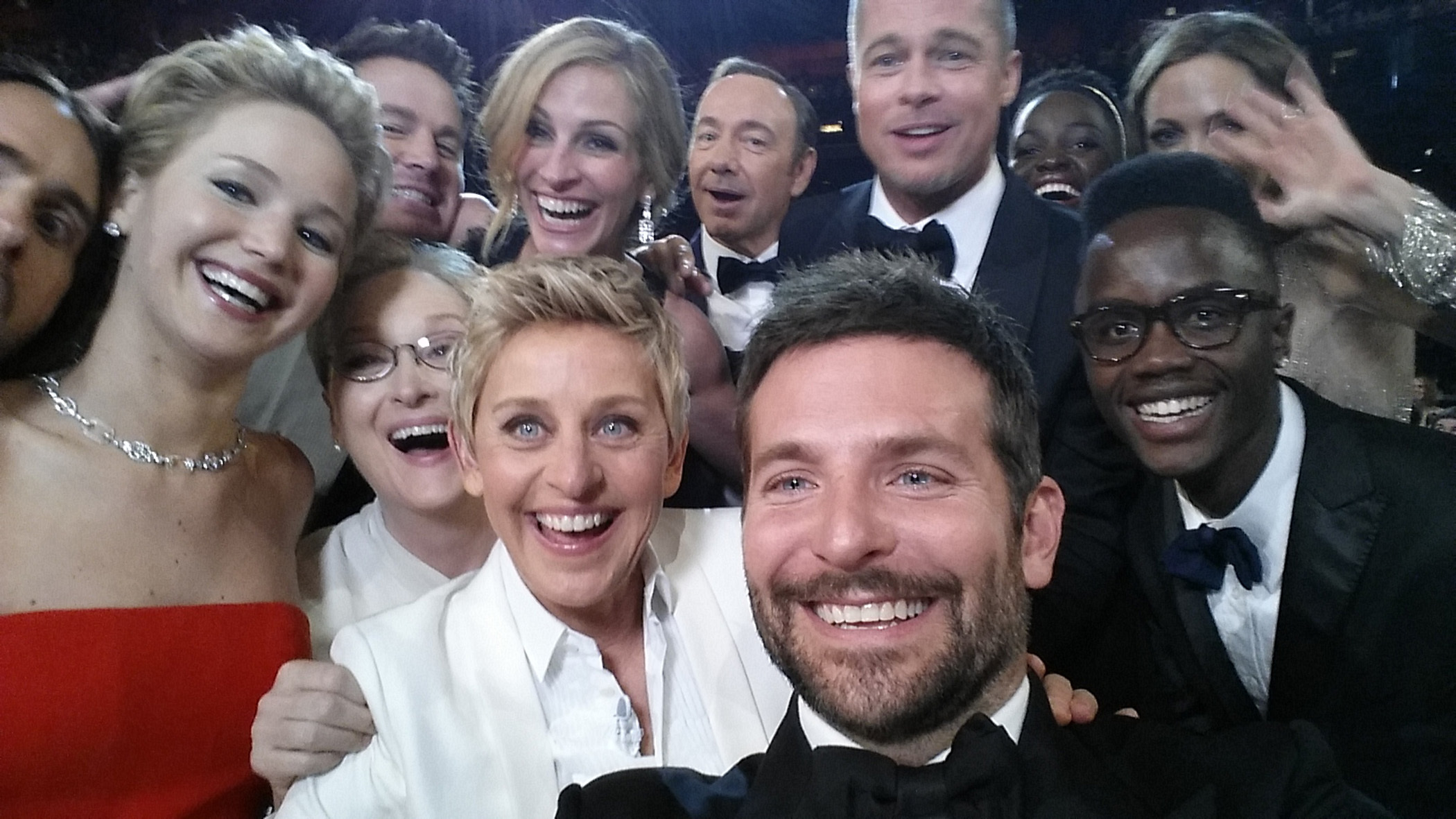 Oscar host Ellen DeGeneres poses for a selfie taken by Bradley Cooper with Jared Leto, Jennifer Lawrence, Channing Tatum, Meryl Streep, Julia Roberts, Kevin Spacey, Brad Pitt, Lupita Nyong'o, Angelina Jolie, Peter Nyong'o Jr. and Bradley Cooper during the 86th Annual Academy Awards at the Dolby Theatre in Hollywood on March 2, 2014.