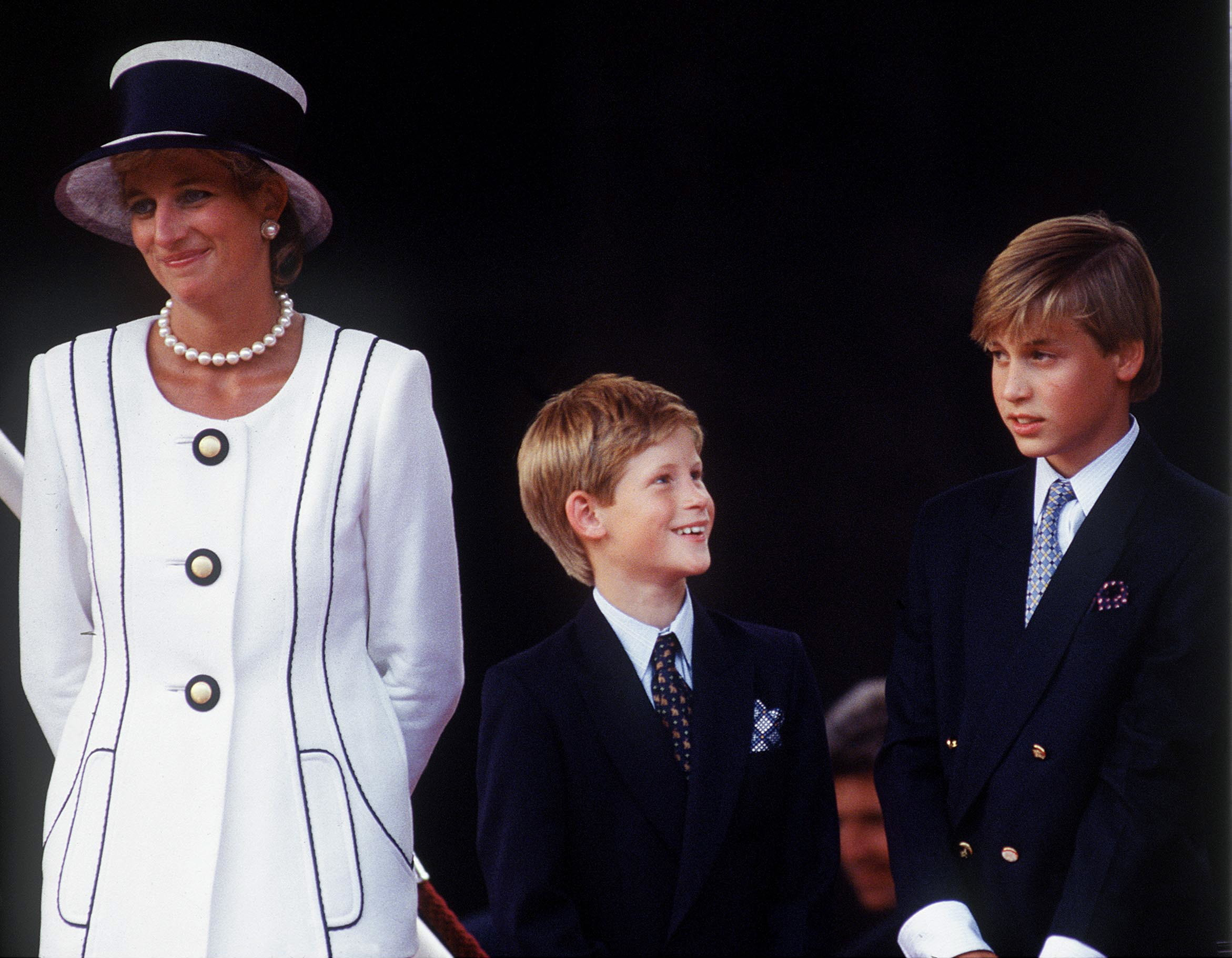 Princess Diana, Prince Harry and Prince William attend a parade to commemorate the 50th anniversary of VJ Day in August 1994.
