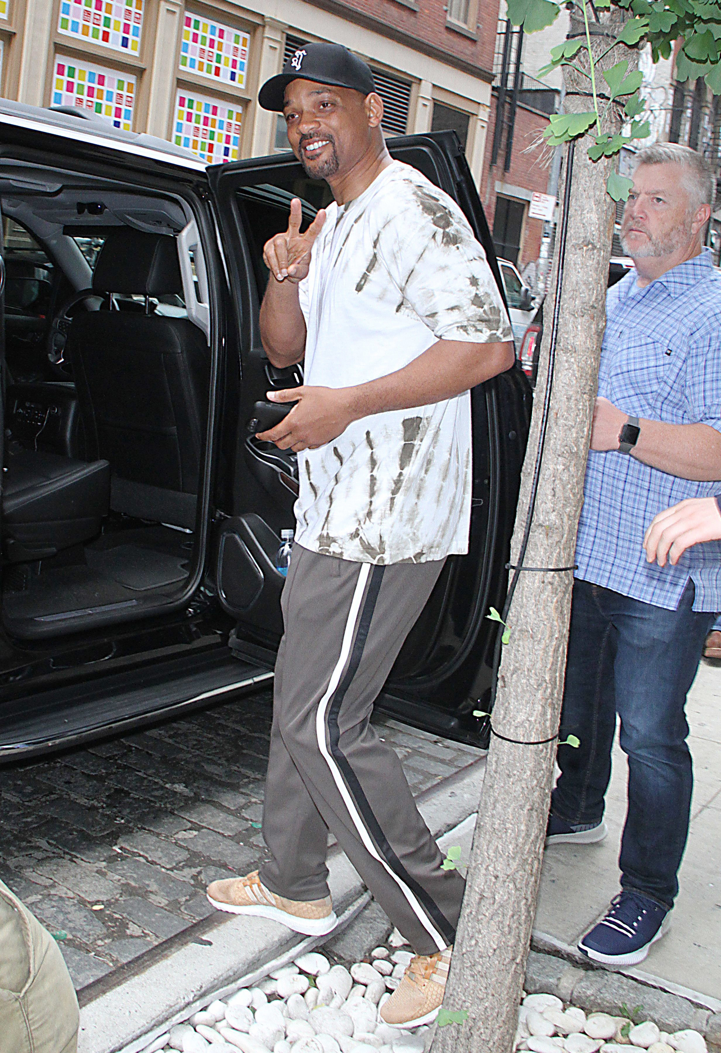 Will Smith flashes the peace sign in New York City on July 24, 2018.
