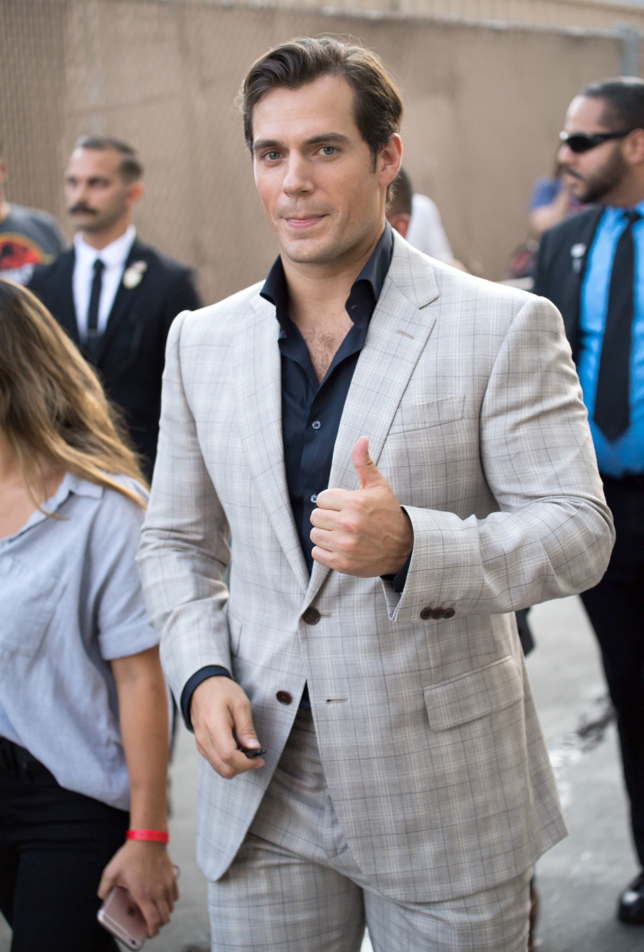 """Henry Cavill flashes a thumbs up as he arrives at the """"Jimmy Kimmel Live!"""" studios in Hollywood on July 25, 2018."""