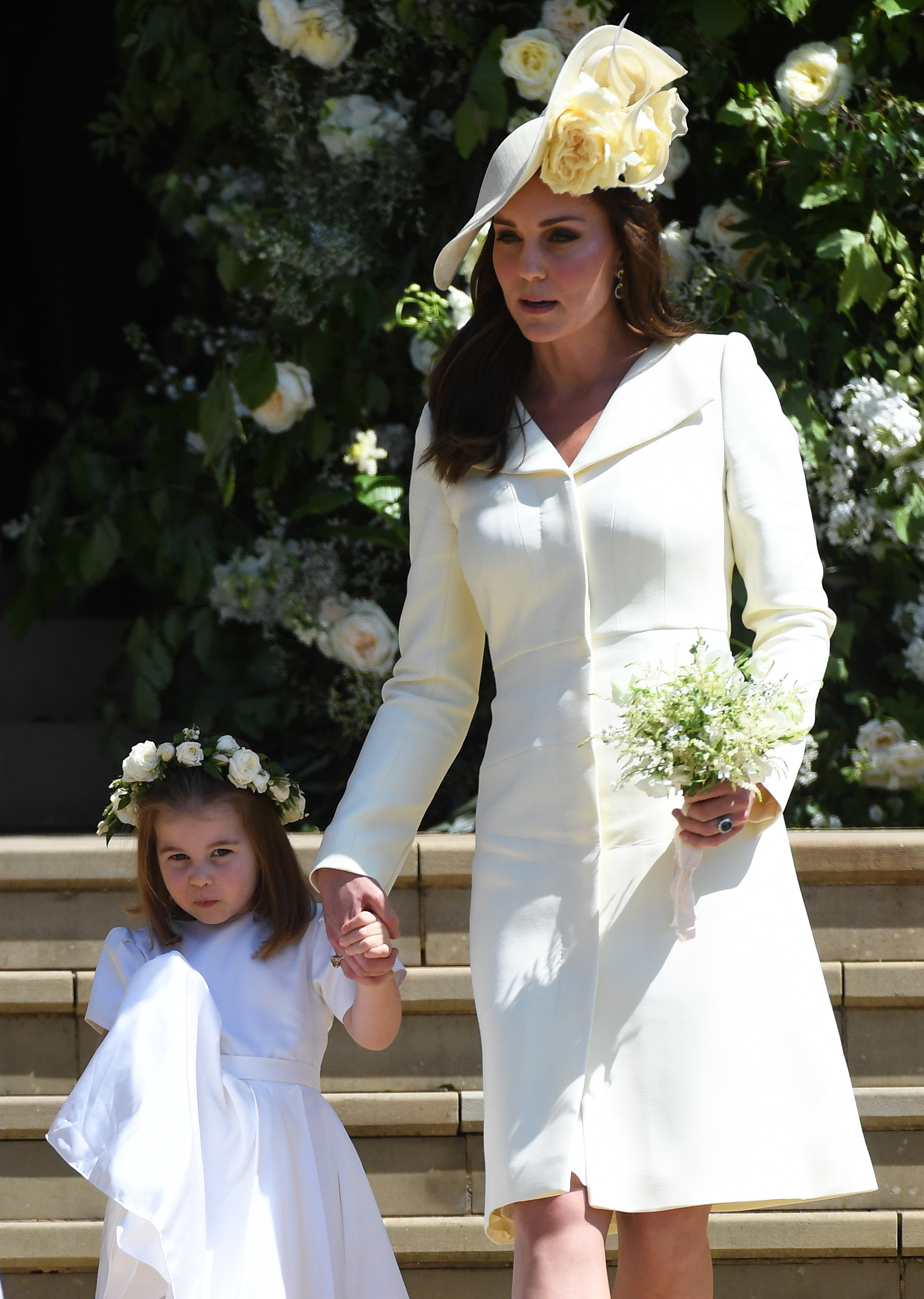 Catherine Duchess of Cambridge and her daughter Princess Charlotte leave St George's Chapel in Windsor Castle after the royal wedding ceremony in Windsor, UK on May 19, 2018.
