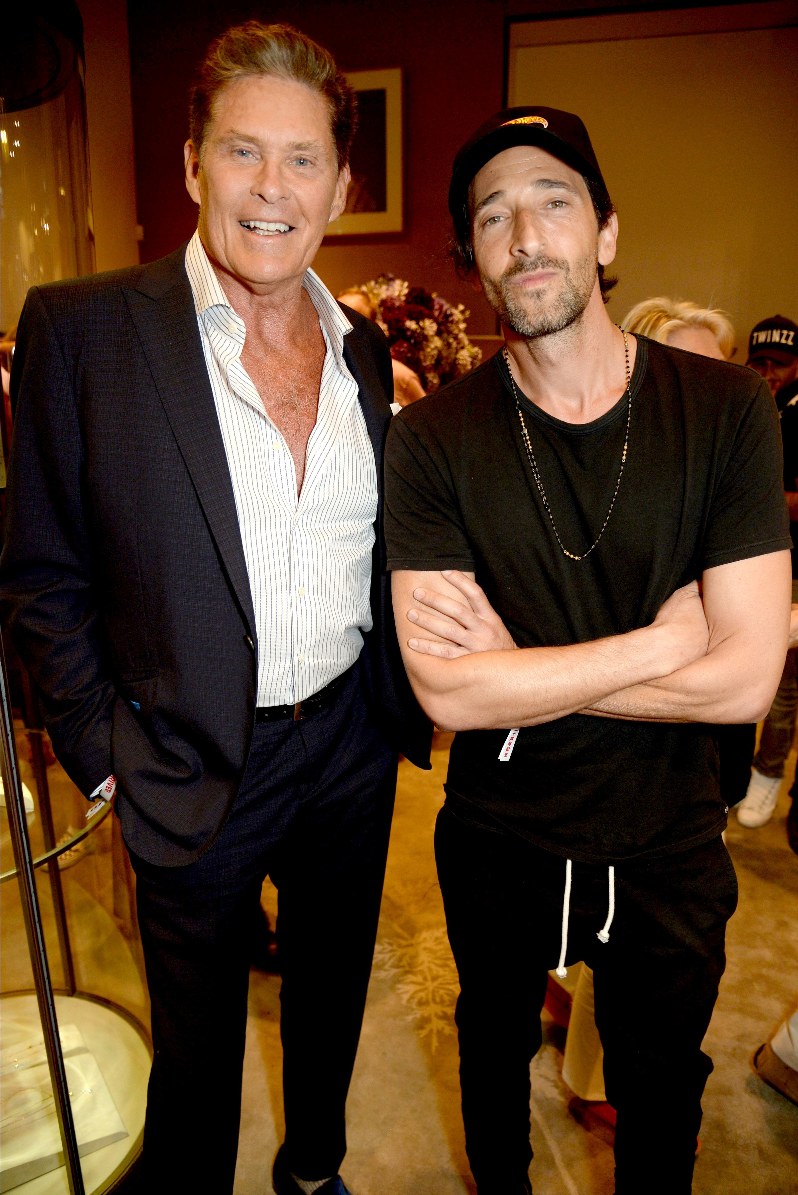 David Hasselhoff and Adrien Brody attend the Gumball 3000 x Asprey 2018 opening party in London on Aug. 4, 2018.