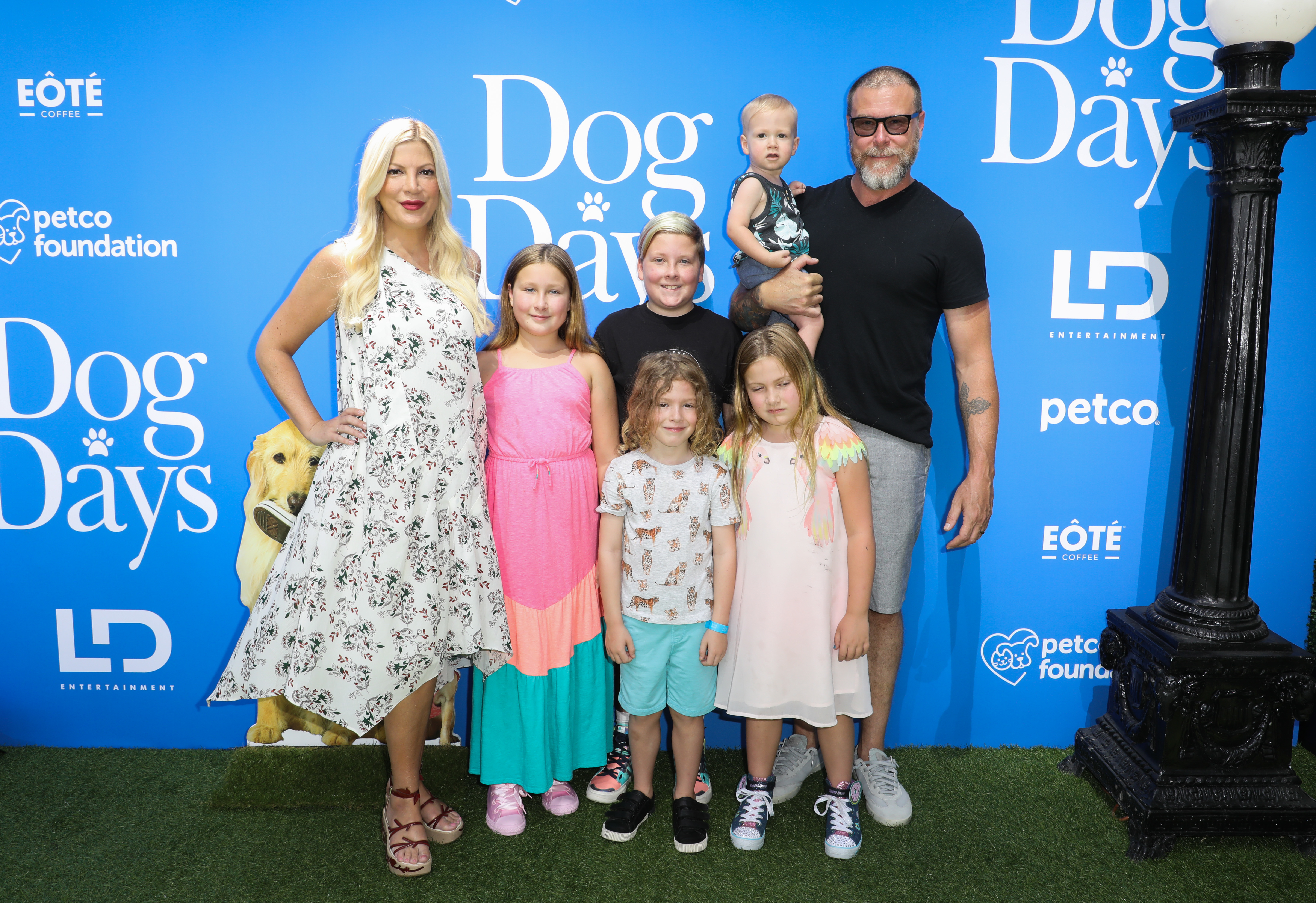 "Tori Spelling, husband Dean McDermott and their kids    Stella, Liam, Finn, Hattie and Beau    attend the premiere of ""Dog Days"" in Los Angeles on Aug. 5, 2018."