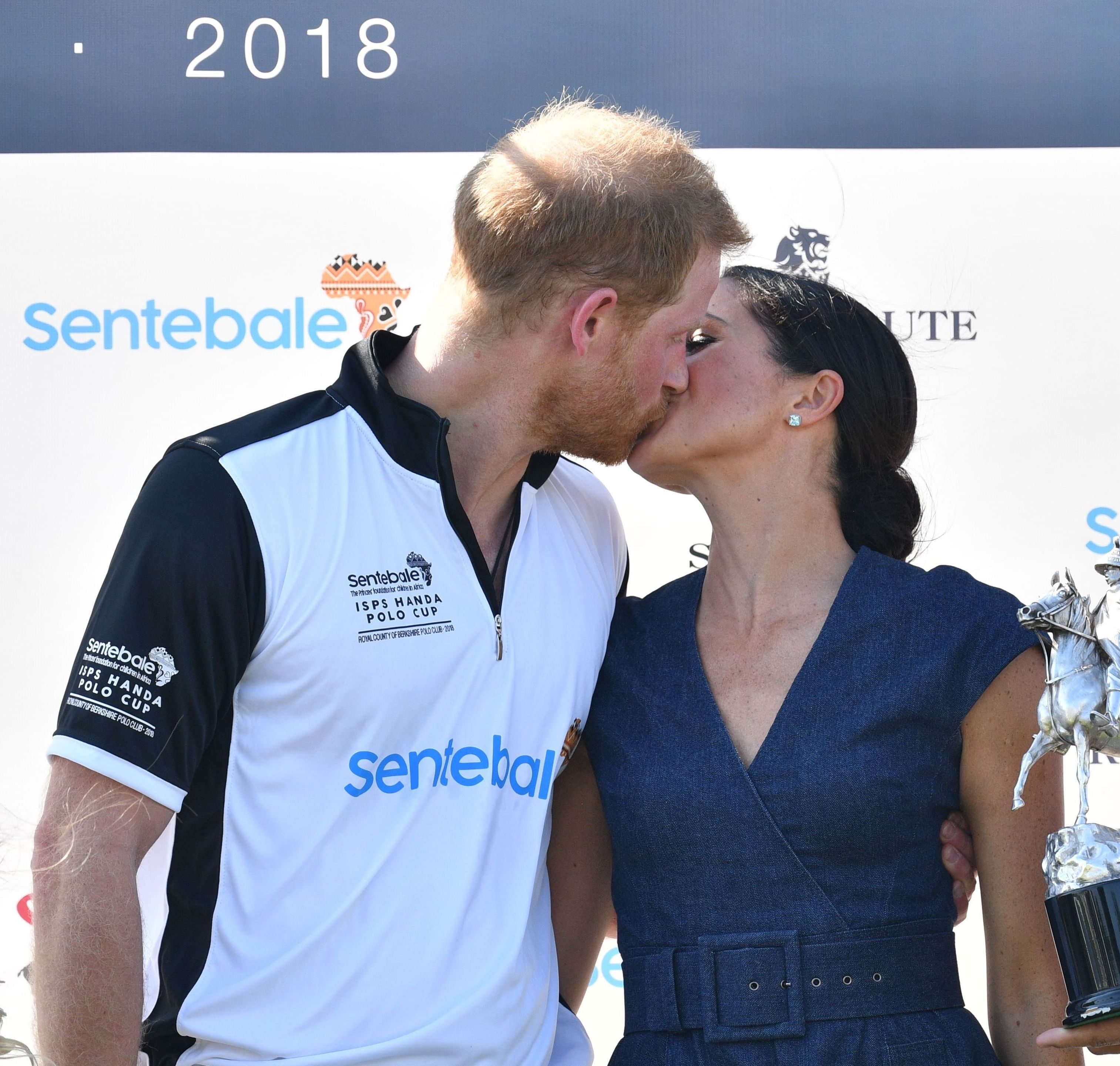 Prince Harry and Duchess Meghan kissed at the  Sentebale ISPS Handa Polo Cup in Windsor, England, on July 16, 2018.