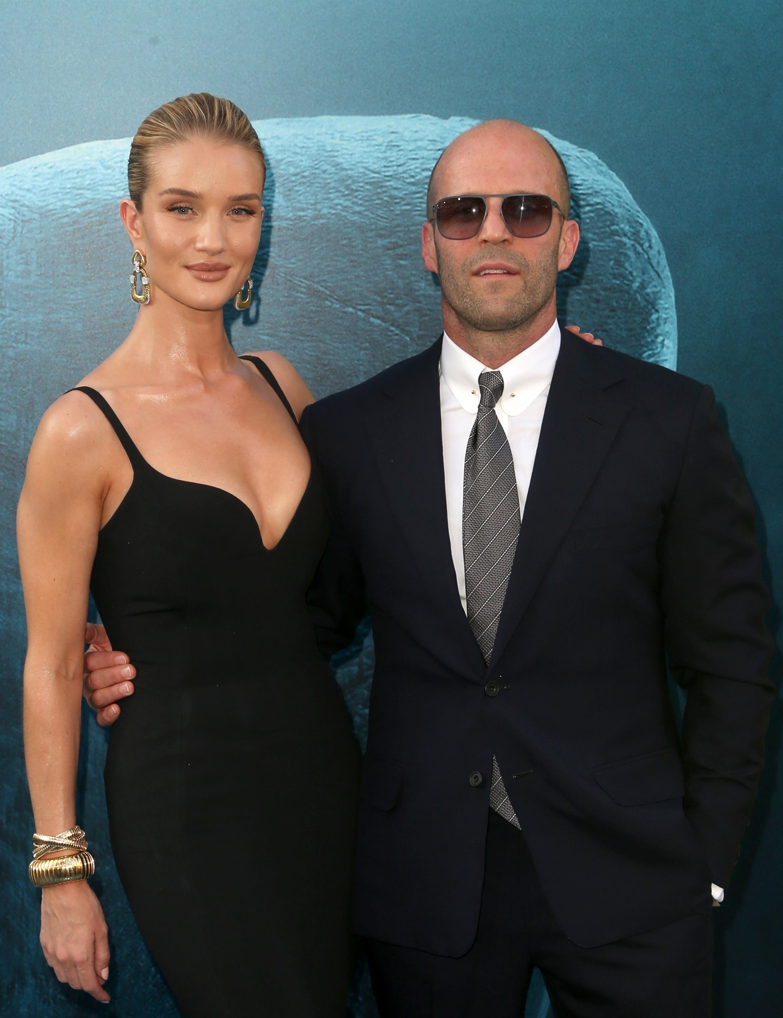 """Rosie Huntington Whiteley and Jason Statham attend the premiere of """"The Meg"""" at the TCL Chinese Theatre in Hollywood on Aug. 6, 2018."""