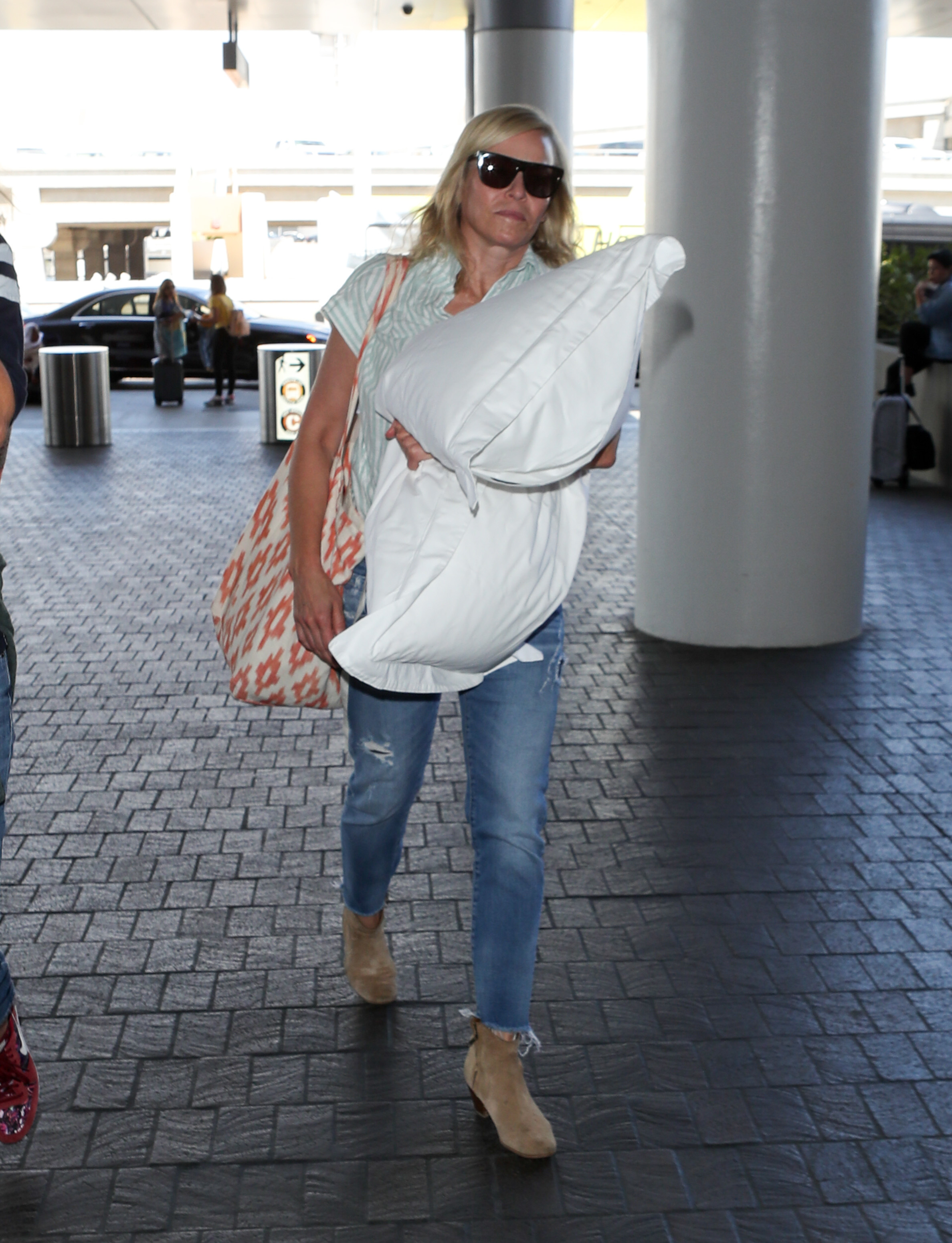 Chelsea Handler was seen carrying her pillow while arriving to LAX in Los Angeles, CA on Aug. 6, 2018.