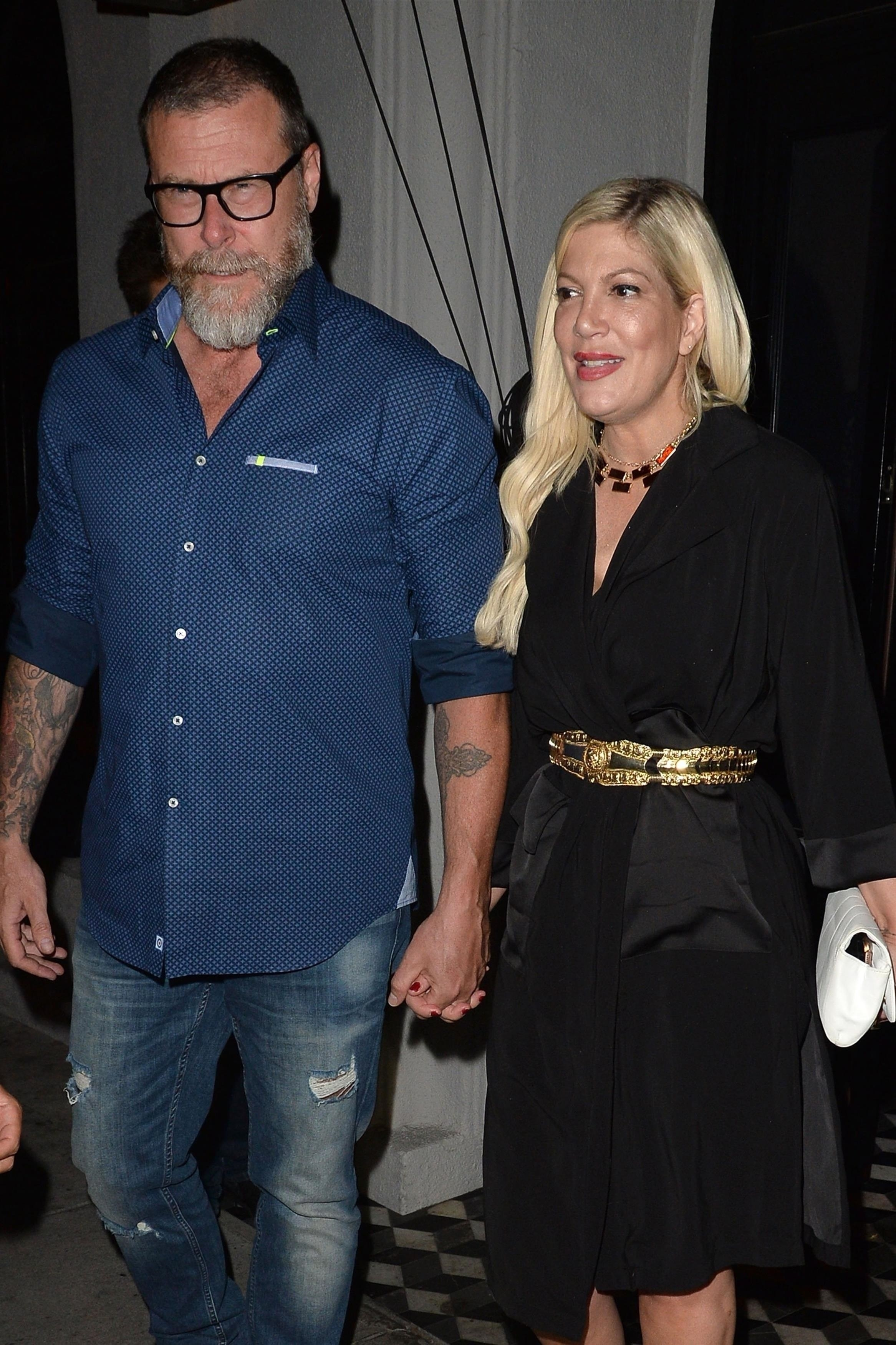 Tori Spelling and Dean McDermott leave after dinner at Craig's in West Hollywood on Aug. 13, 2018.