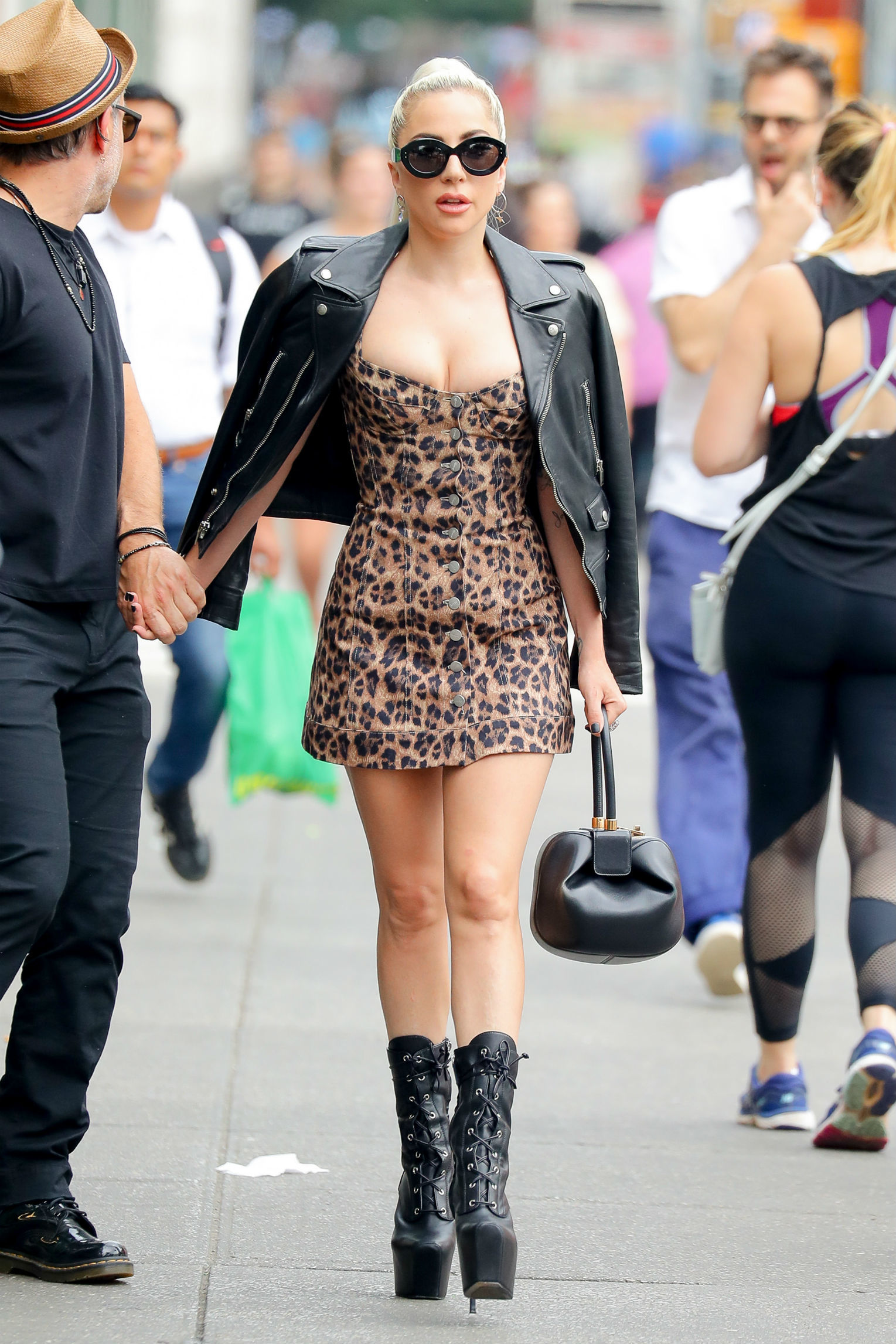 Lady Gaga wears a leopard print mini dress under a motorcycle leather jacket in New York City on June 28, 2018.