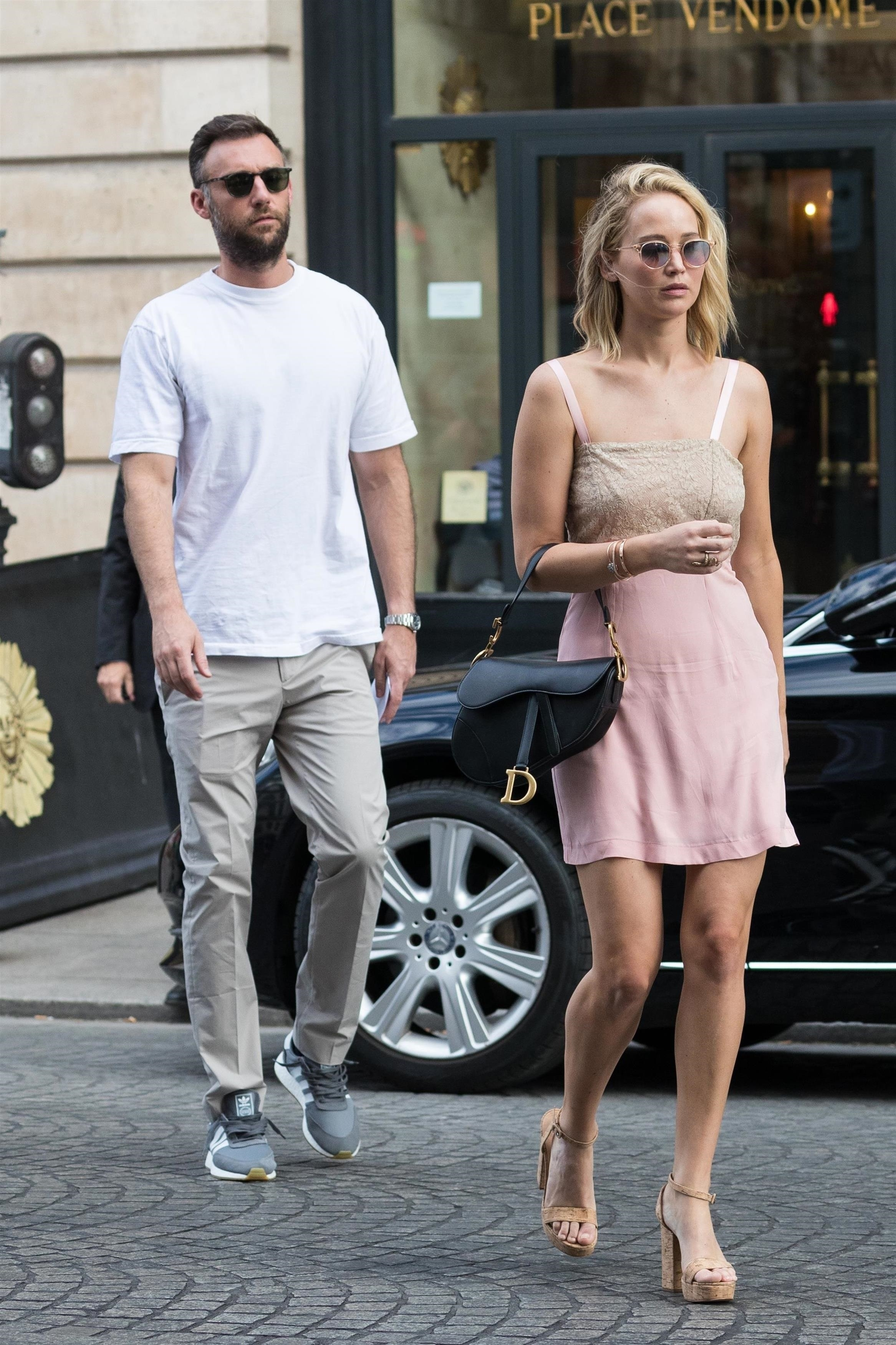 Jennifer Lawrence and her boyfriend Cooke Maroney stroll through Place Vedome in Paris on Aug. 8, 2018.
