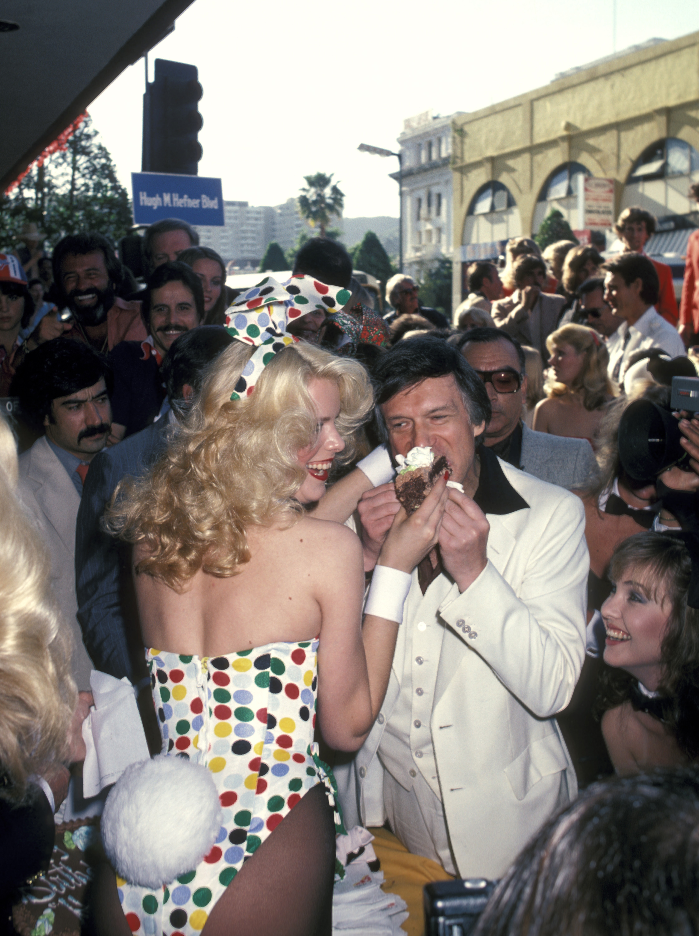 Hugh Hefner is feed a cupcake from a Playboy bunny while being honored with a star on the Hollywood Walk of Fame in Hollywood, California on April 9, 1980.