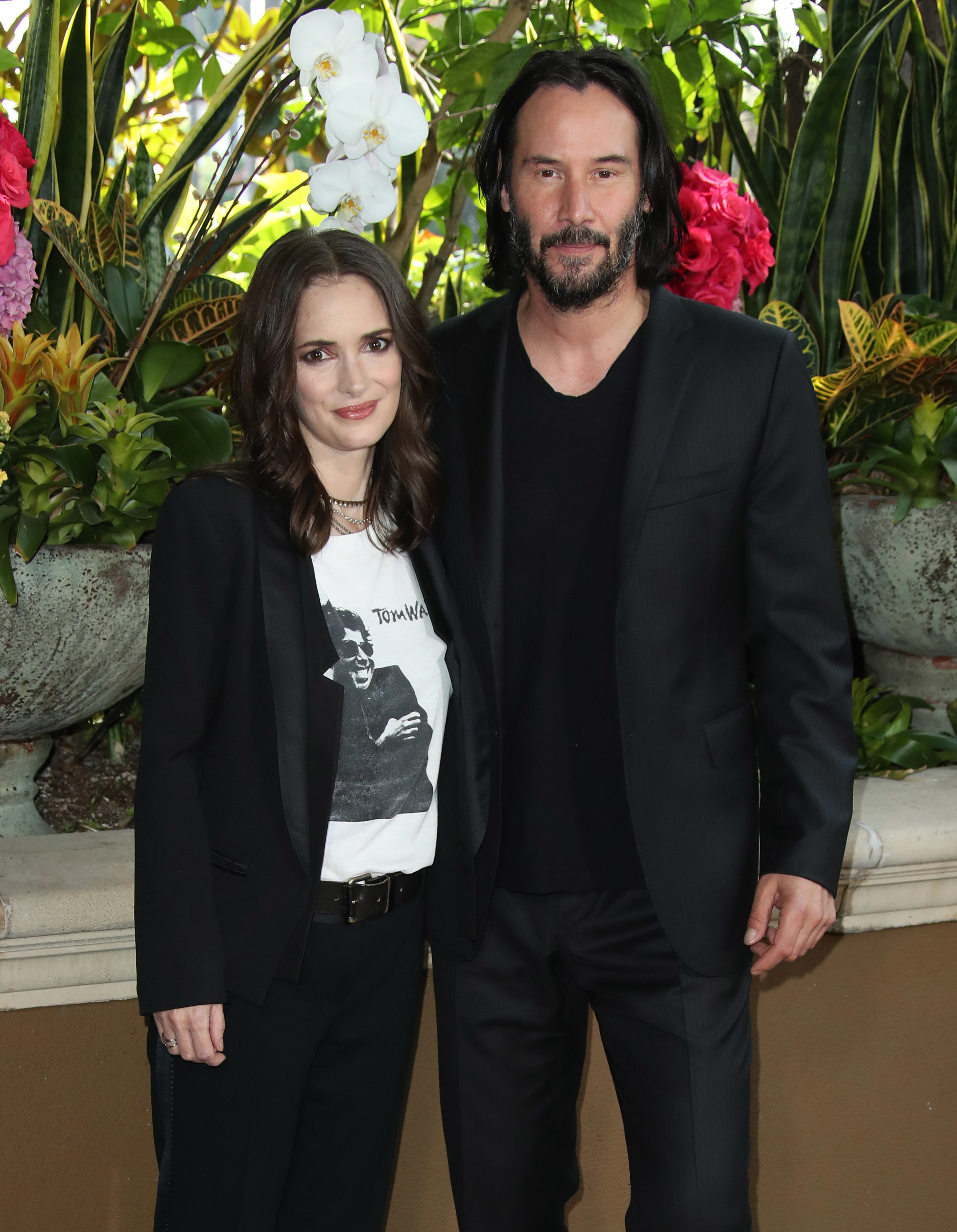 """Winona Ryder and Keanu Reeves attend the """"Destination Wedding"""" film photo call in Los Angeles on Aug. 18, 2018."""
