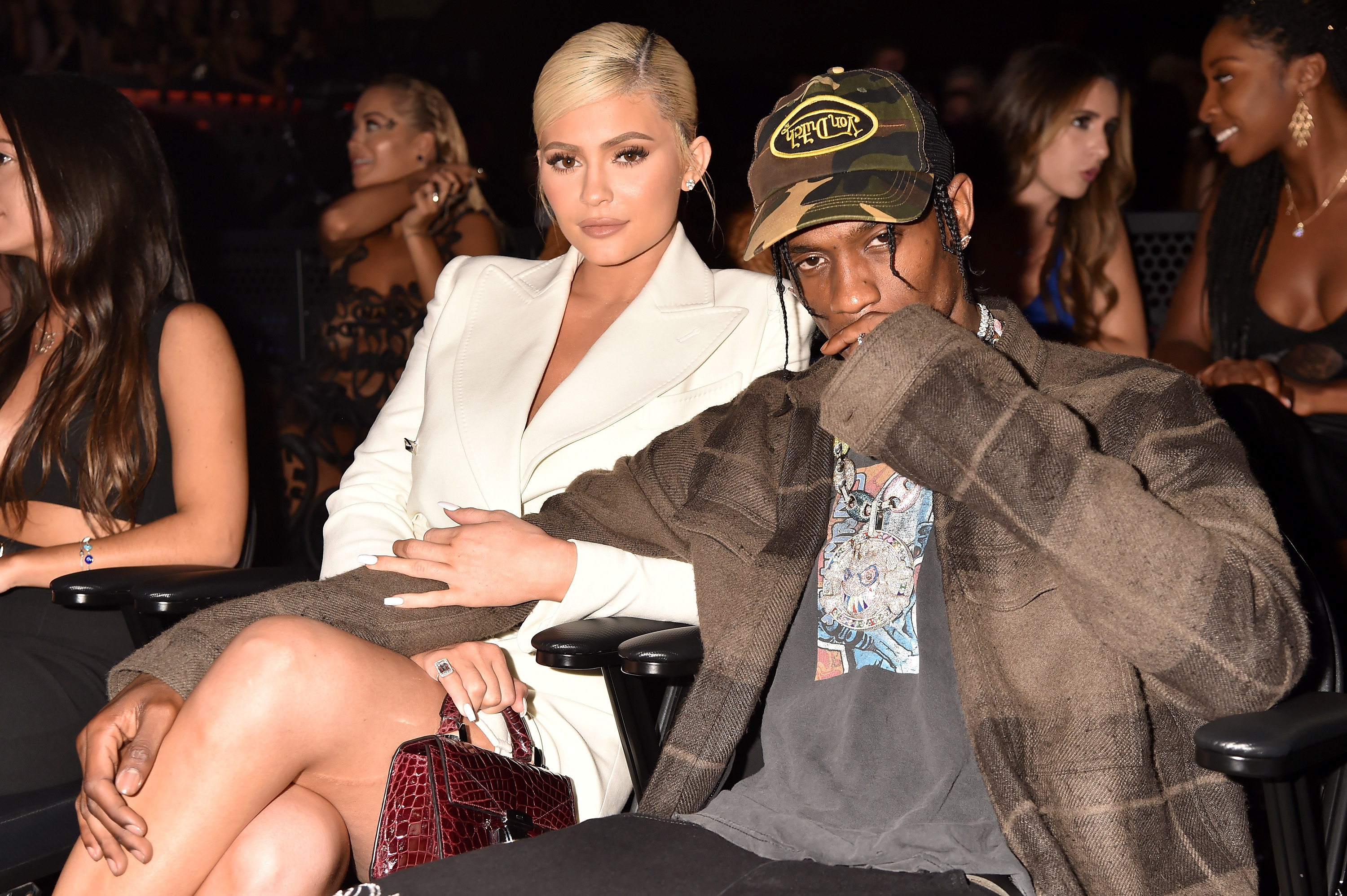 Kylie Jenner and Travis Scott sit together during the MTV Video Music Awards at Radio City Music Hall in New York City on Aug. 20, 2018.