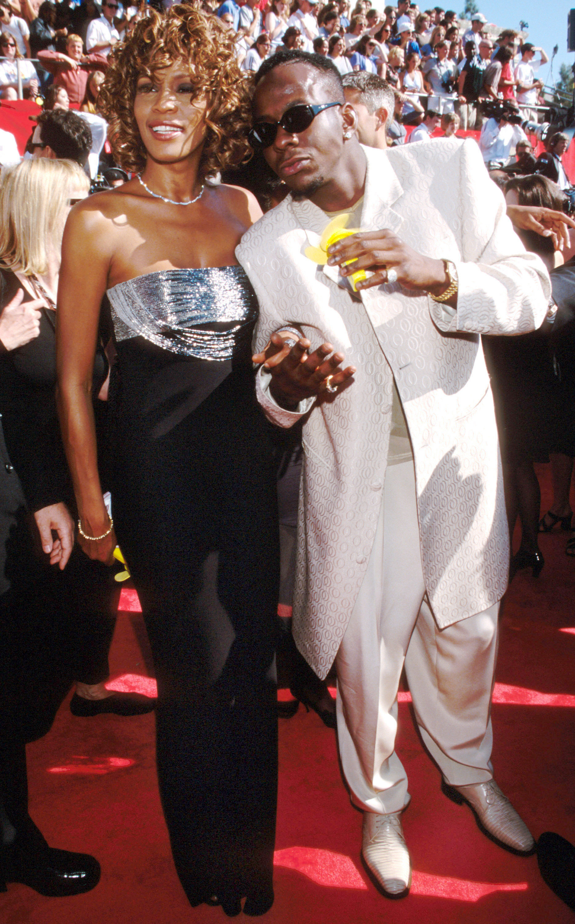 Whitney Houston and Bobby Brown attend the 1998 Primetime Emmy Awards at the Shrine Auditorium in Los Angeles on Sept. 13, 1998.