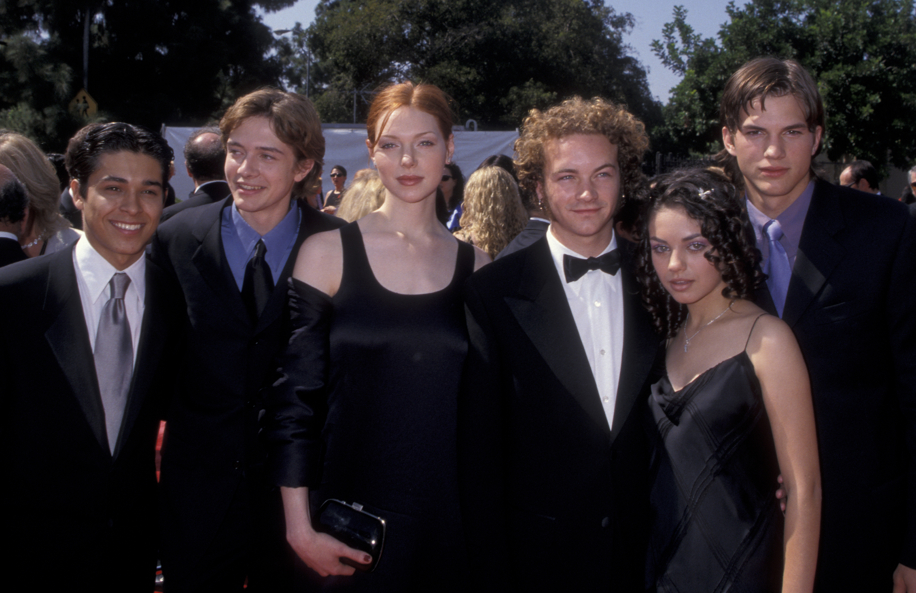 Wilmer Valderrama, Topher Grace, Laura Prepon, Danny Masterson, Mila Kunis and Ashton Kutcher attend the 1998 Primetime Emmy Awards at the Shrine Auditorium in Los Angeles on Sept. 13, 1998.