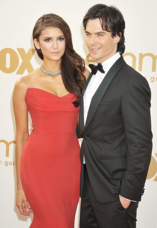 Nina Dobrev and Ian Somerhalder arrive at the 63rd Primetime Emmy Awards in Los Angeles on Sept. 18, 2011.