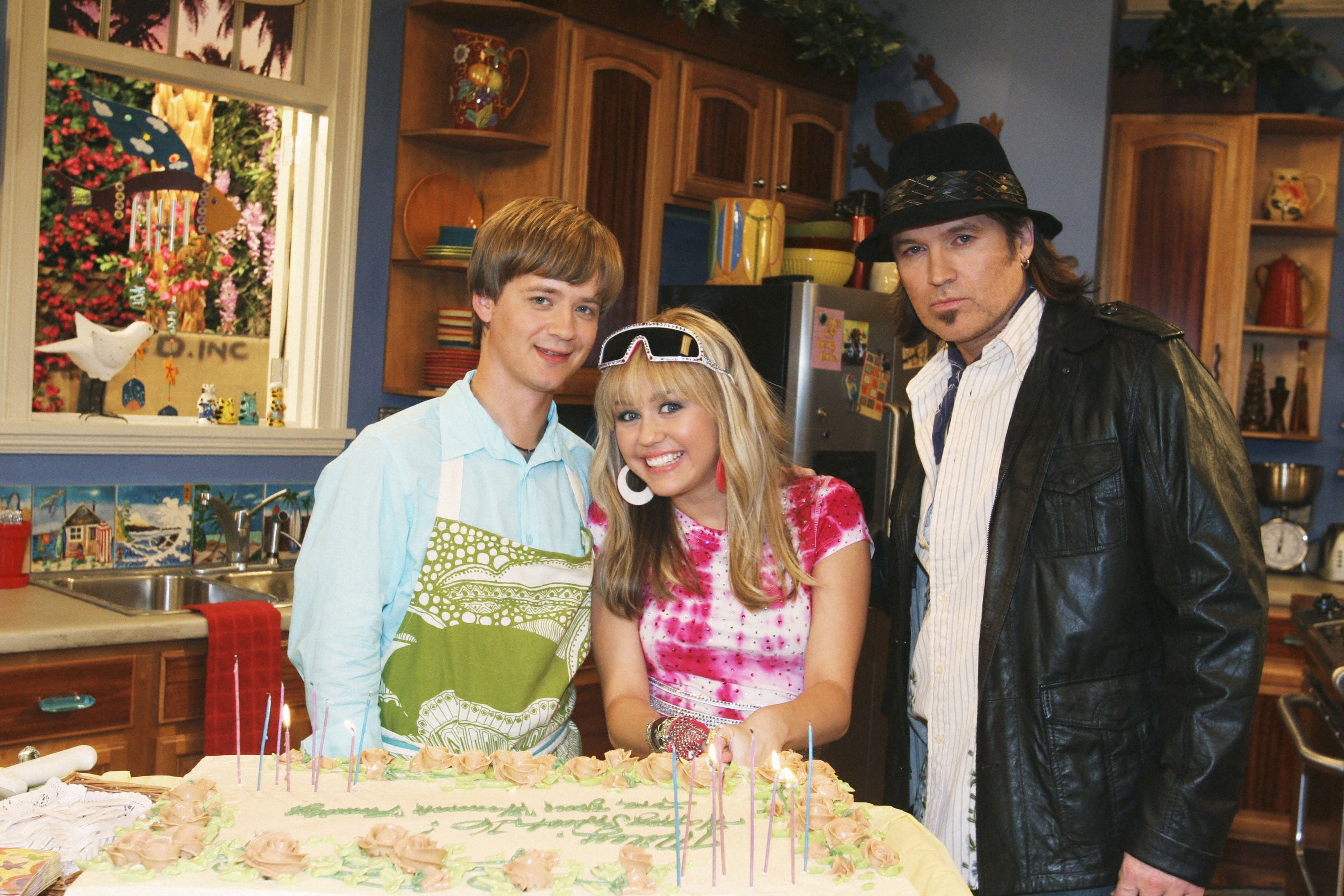"""Jason Earles, Miley Cyrus, and Billy Ray Cyrus appear in """"Hannah Montana"""" in 2006."""